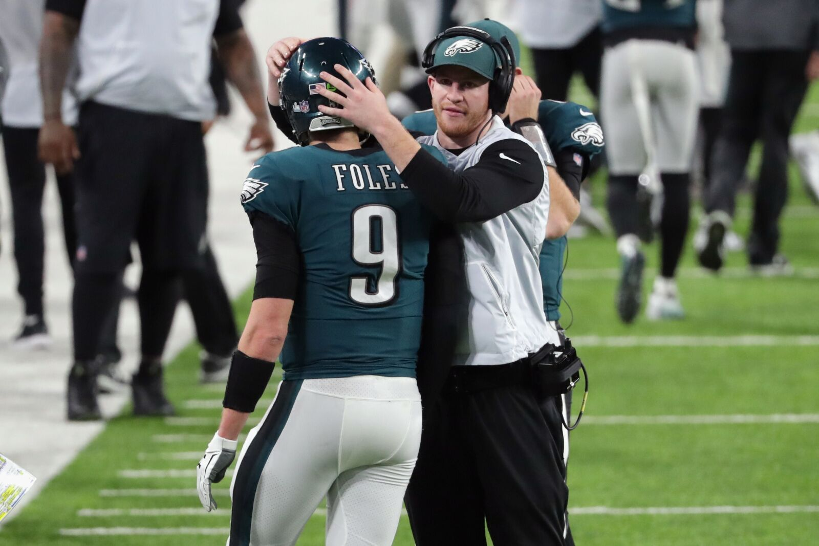 MINNEAPOLIS, MN - FEBRUARY 04: Nick Foles #9 of the Philadelphia Eagles is congratulated by his teammate Carson Wentz #11 after his 11-yard touchdown pass during the fourth quarter against the New England Patriots in Super Bowl LII at U.S. Bank Stadium on February 4, 2018 in Minneapolis, Minnesota. (Photo by Streeter Lecka/Getty Images)