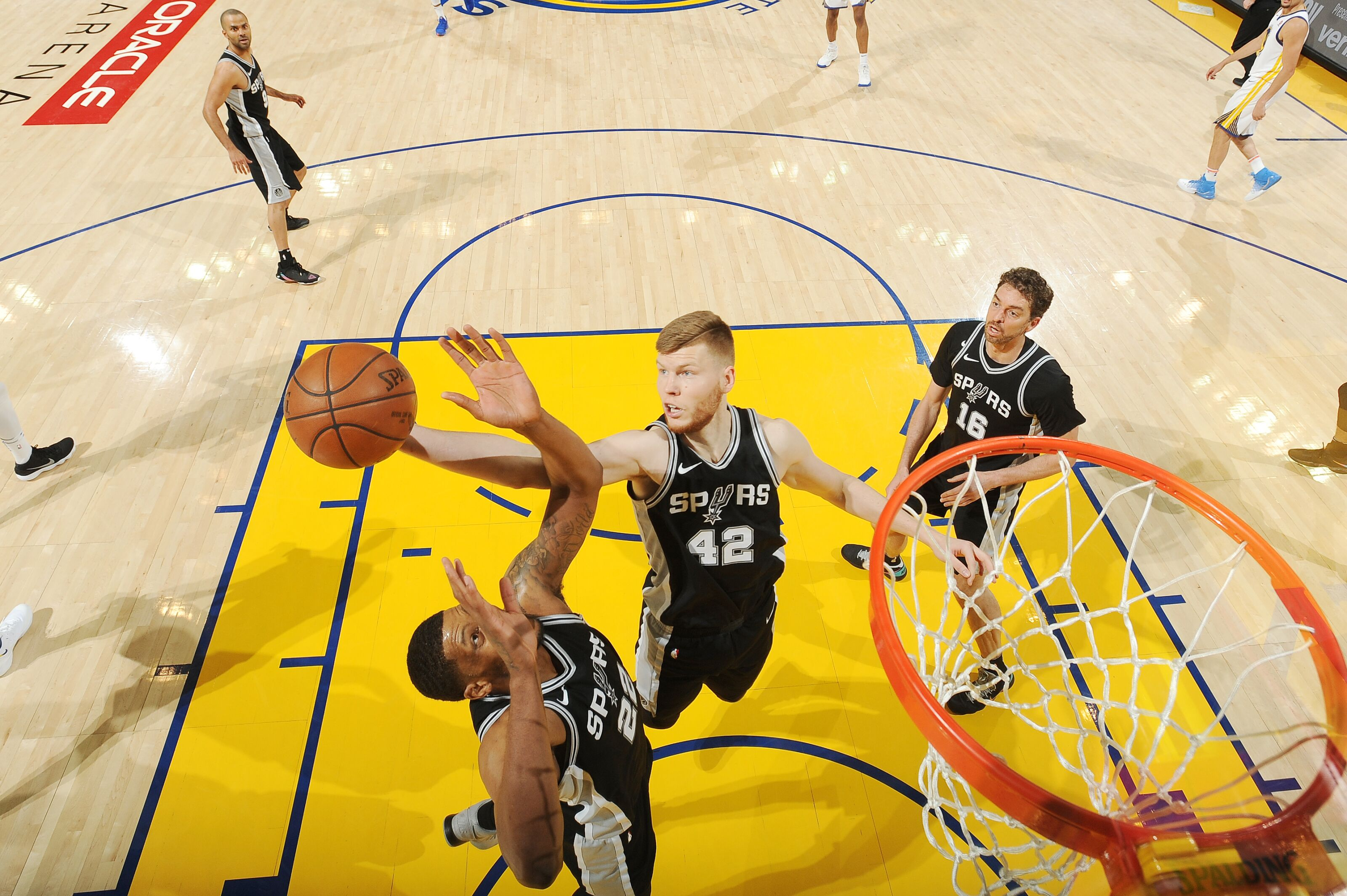 OAKLAND, CA - APRIL 14: Davis Bertans #42 of the San Antonio Spurs grabs the rebound against the Golden State Warriors in Game One of Round One of the 2018 NBA Playoffs on April 14, 2018 at ORACLE Arena in Oakland, California. NOTE TO USER: User expressly acknowledges and agrees that, by downloading and or using this photograph, user is consenting to the terms and conditions of Getty Images License Agreement. Mandatory Copyright Notice: Copyright 2018 NBAE (Photo by Noah Graham/NBAE via Getty Images)