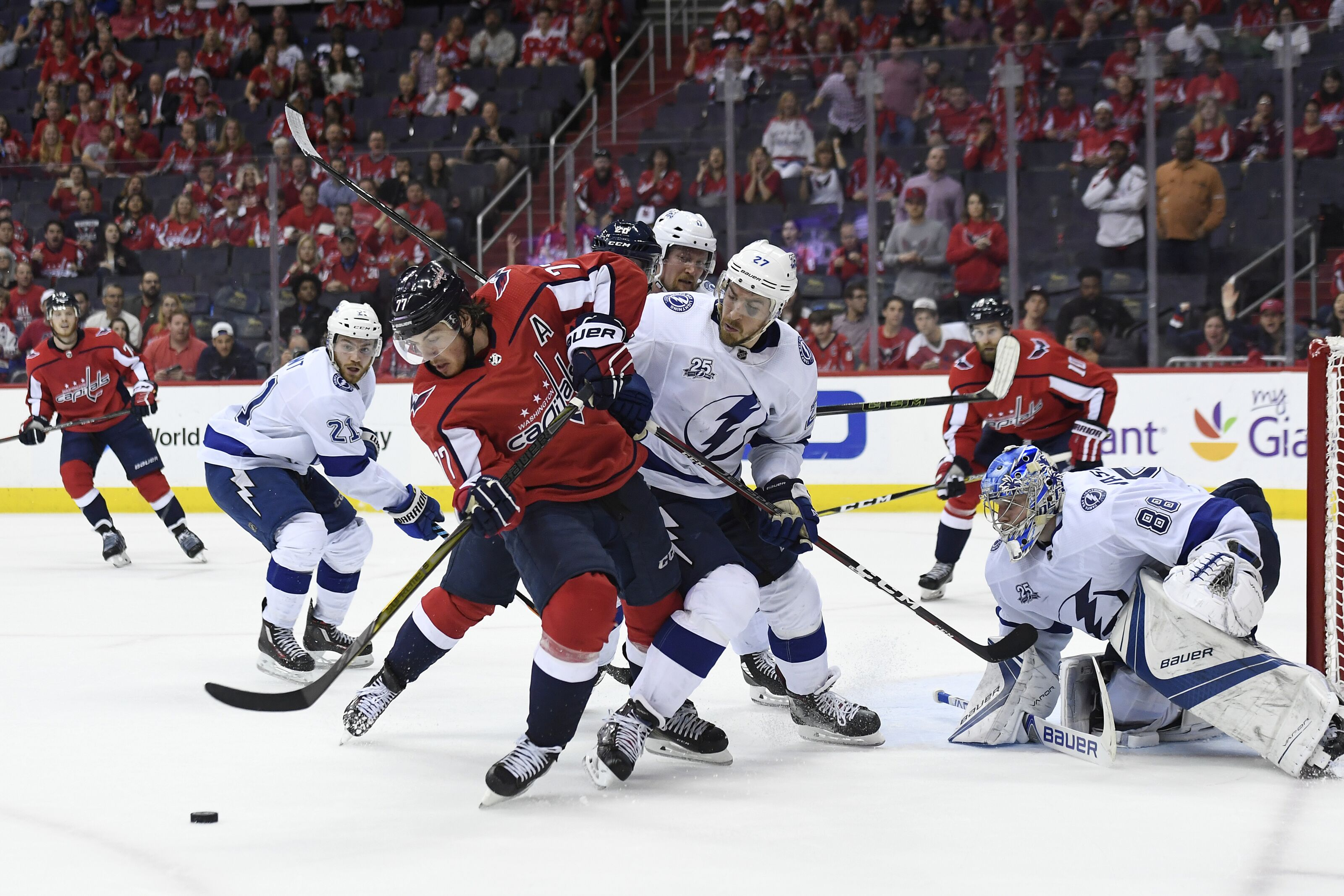 WASHINGTON, DC - MAY 15: T.J. Oshie #77 of the Washington Capitals battles for the puck against Ryan McDonagh #27 of the Tampa Bay Lightning in the third period in Game Three of the Eastern Conference Final during the 2018 NHL Stanley Cup Playoffs at Capital One Arena on May 15, 2018 in Washington, DC. (Photo by Patrick McDermott/NHLI via Getty Images)