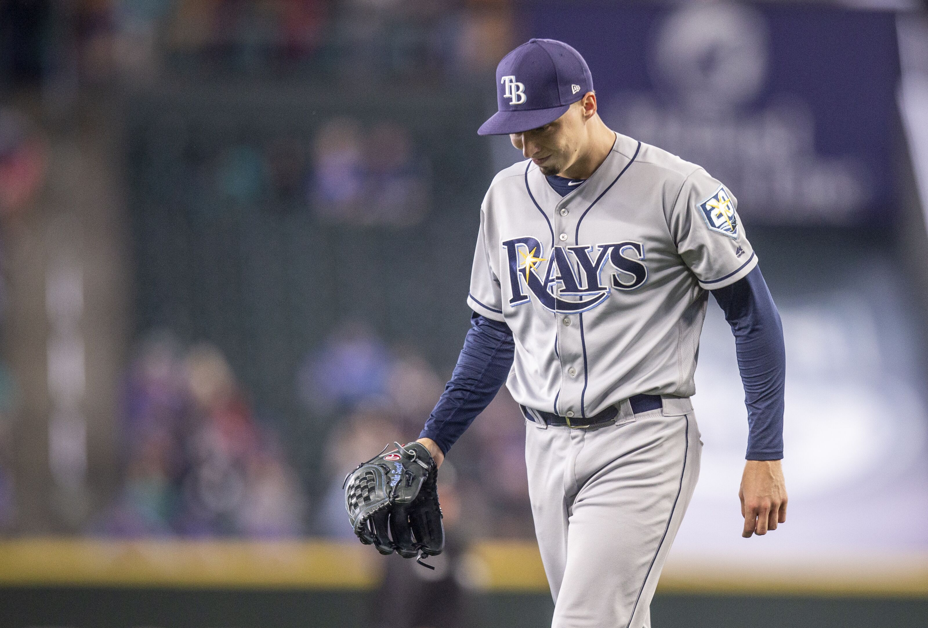 SEATTLE, WA - JUNE 3: Starting pitcher Blake Snell #4 of the Tampa Bay Rays walks off the field after pitching the second inning of a game against the Seattle Mariners at Safeco Field on June 3, 2018 in Seattle, Washington. The Mariners won 2-1. (Photo by Stephen Brashear/Getty Images)