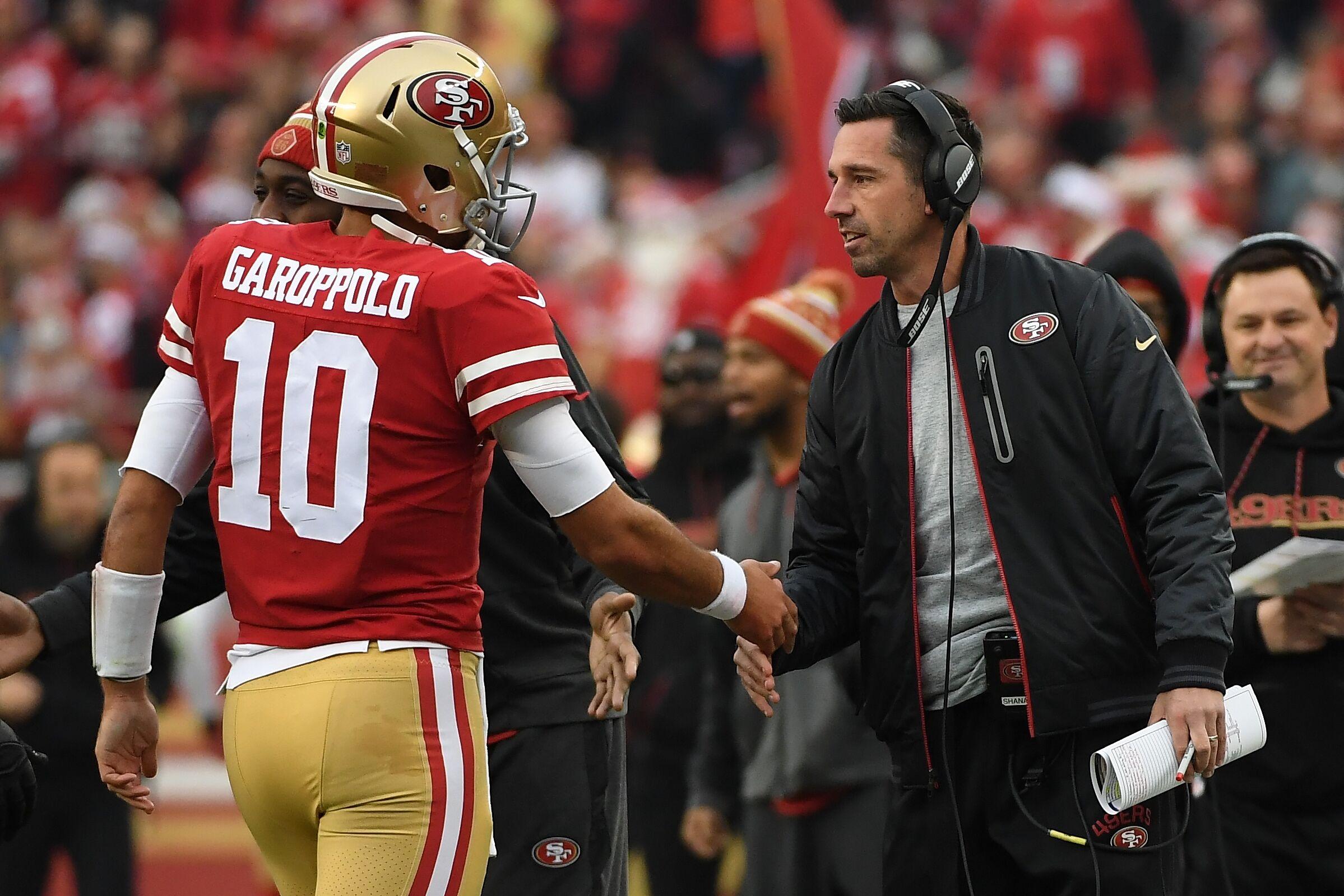 SANTA CLARA, CA - DECEMBER 24: Head coach Kyle Shanahan of the San Francisco 49ers congratulates Jimmy Garoppolo