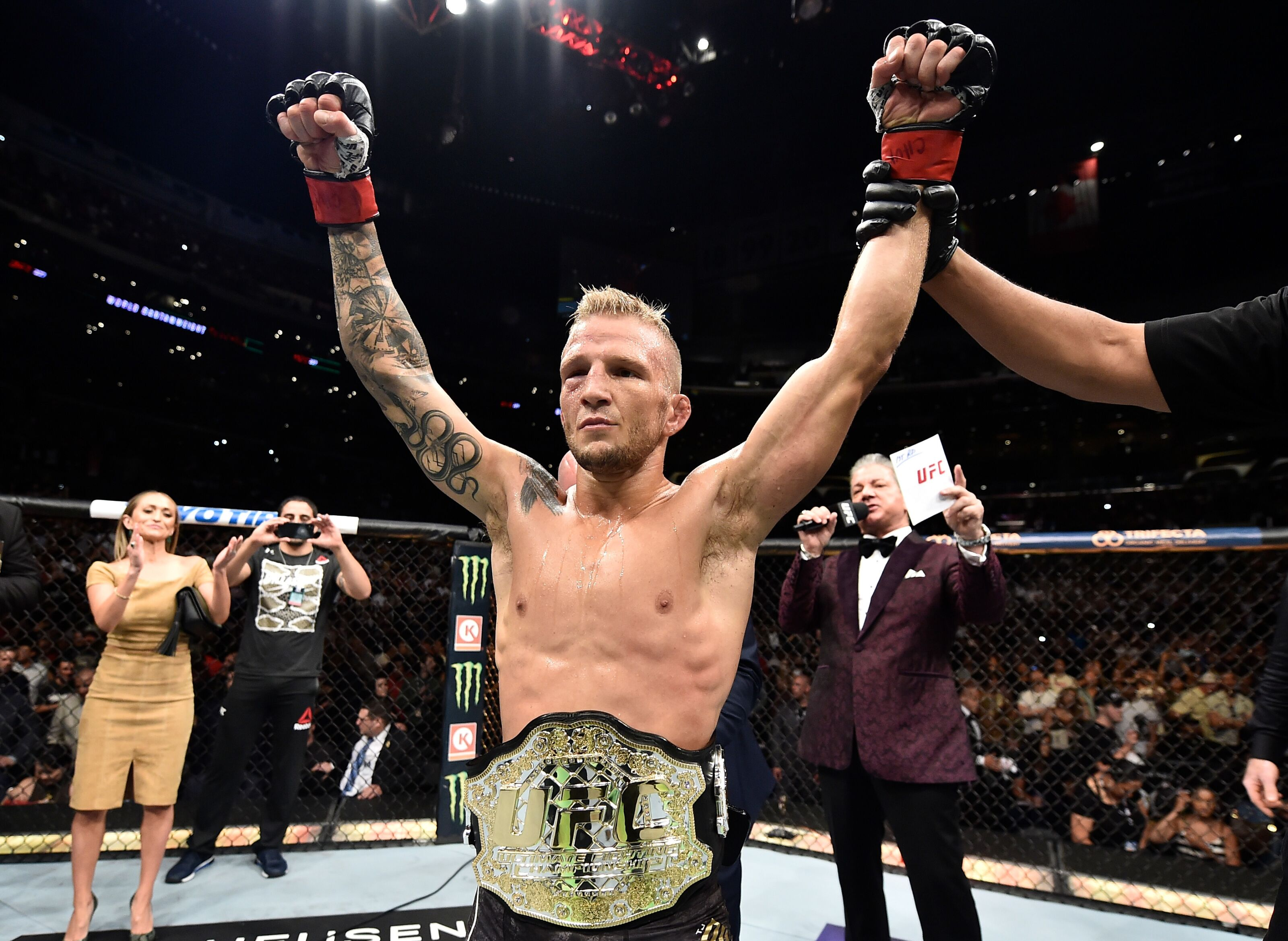 LOS ANGELES, CA - AUGUST 04: TJ Dillashaw celebrates after his knockout victory over Cody Garbrandt in their UFC bantamweight championship fight during the UFC 227 event inside Staples Center on August 4, 2018 in Los Angeles, California. (Photo by Jeff Bottari/Zuffa LLC/Zuffa LLC via Getty Images)