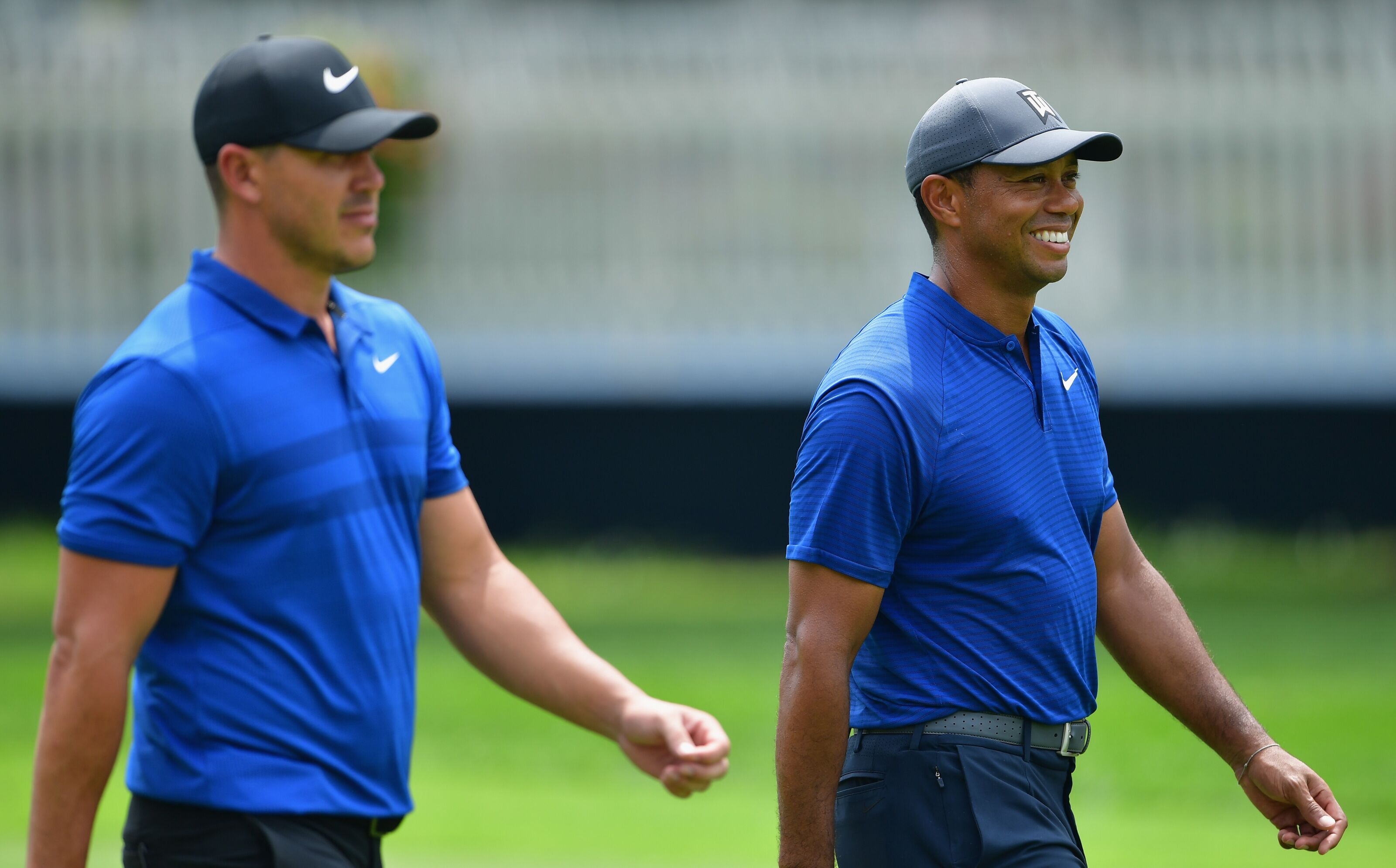 ST LOUIS, MO - AUGUST 08: Brooks Koepka and Tiger Woods of the United States walk together during a practice round prior to the 2018 PGA Championship at Bellerive Country Club on August 8, 2018 in St Louis, Missouri. (Photo by Stuart Franklin/Getty Images)