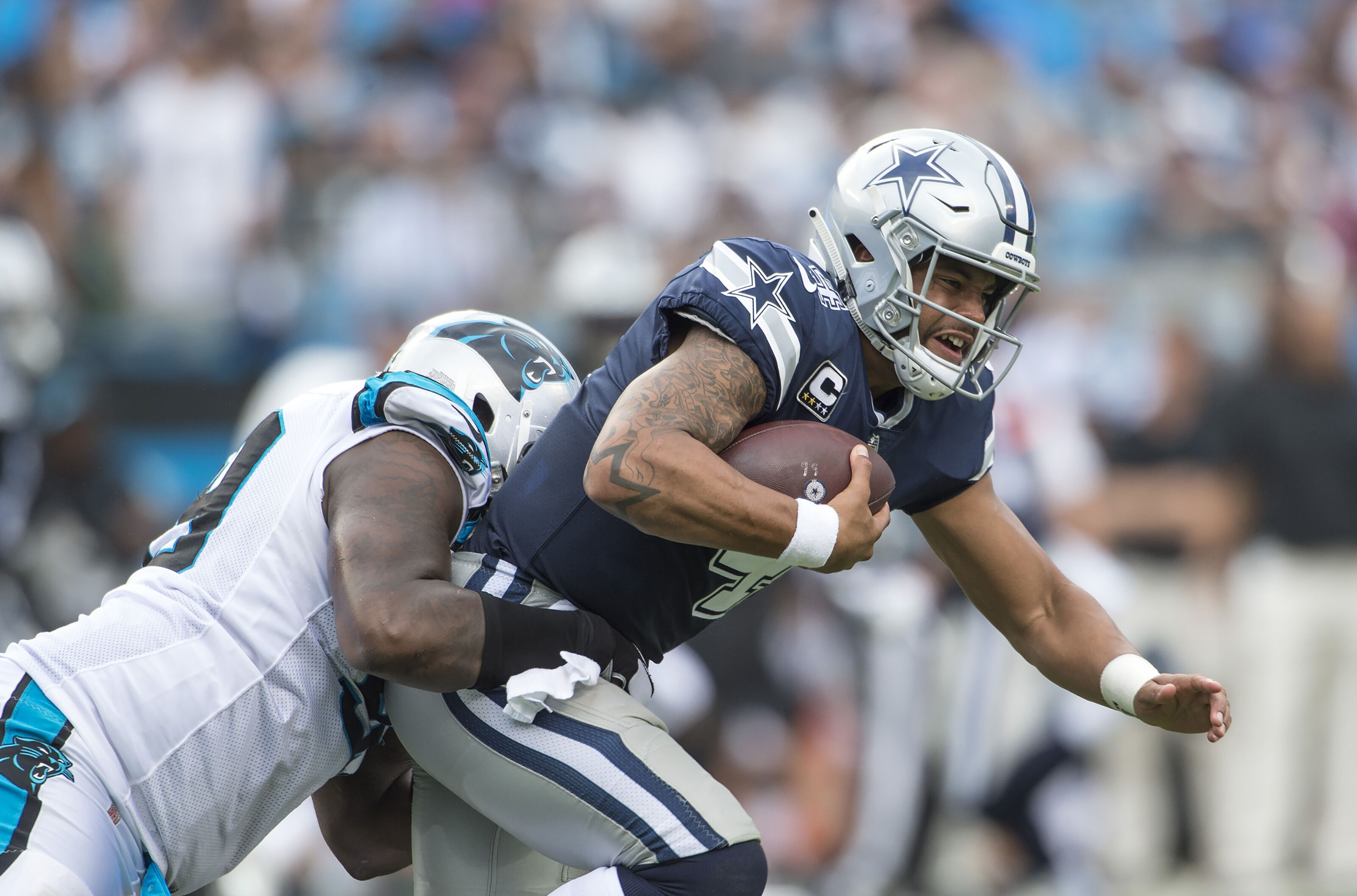 CHARLOTTE, NC - SEPTEMBER 09: Quarterback Dak Prescott #4 of the Dallas Cowboys scrambles during a NFL game against the Carolina Panthers at Bank of America Stadium on September 9, 2018 in Charlotte, North Carolina. (Photo by Ronald C. Modra/Sports Imagery/ Getty Images)