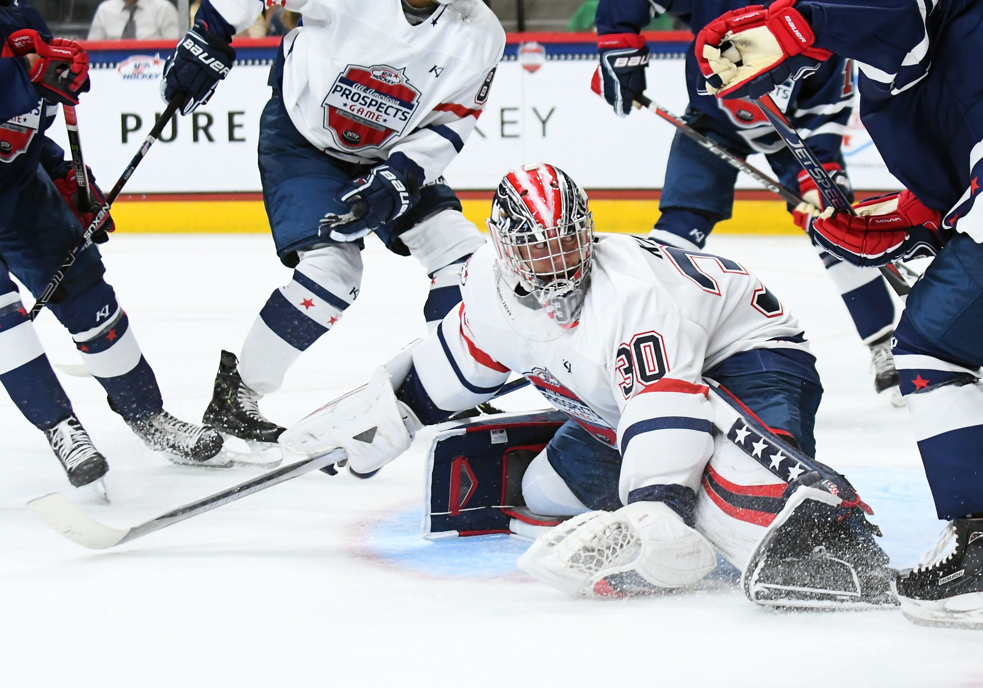 ST. PAUL, MN - SEPTEMBER 19: Team Langenbrunner goalie Spencer Knight (30) kicks the puck into the corner during the USA Hockey All-American Prospects Game between Team Leopold and Team Langenbrunner on September 19, 2018 at Xcel Energy Center in St. Paul, MN. Team Leopold defeated Team Langenbrunner 6-4.(Photo by Nick Wosika/Icon Sportswire via Getty Images)