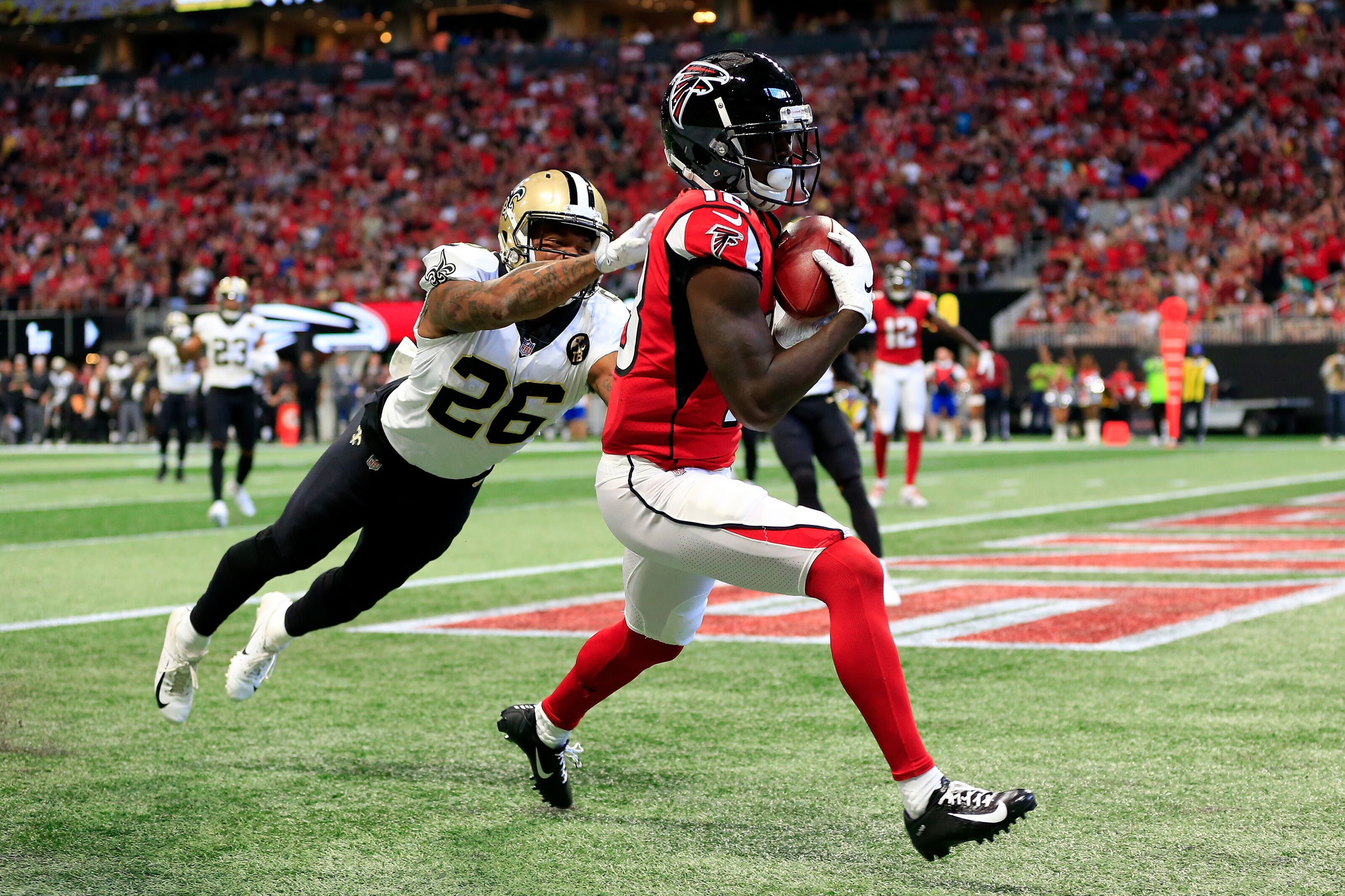 ATLANTA, GA - SEPTEMBER 23: Calvin Ridley #18 of the Atlanta Falcons catches a touchdown pass over P.J. Williams #26 of the New Orleans Saints during the first half at Mercedes-Benz Stadium on September 23, 2018 in Atlanta, Georgia. (Photo by Daniel Shirey/Getty Images)