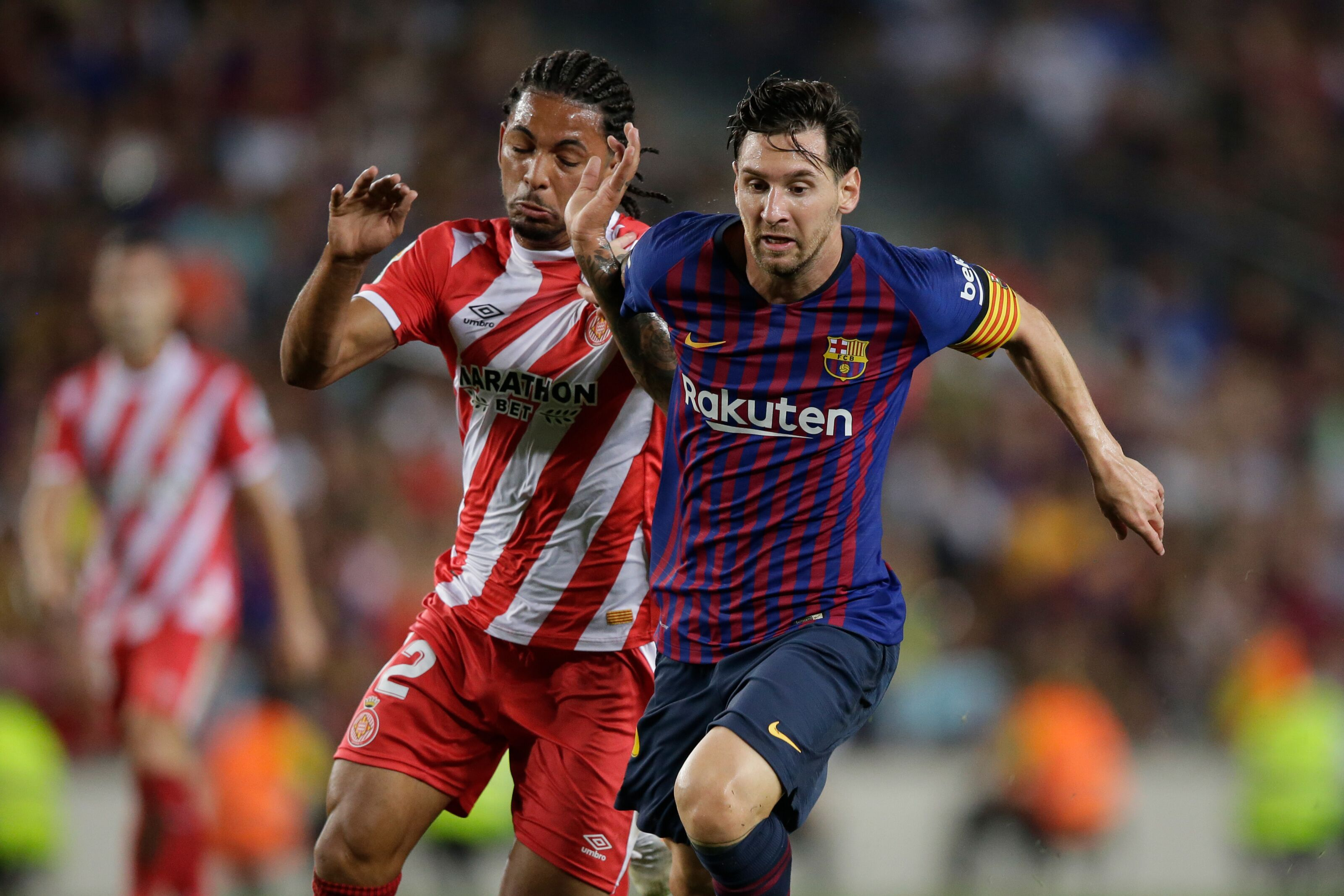 BARCELONA, SPAIN - SEPTEMBER 23: (L-R) Douglas of Girona, Lionel Messi of FC Barcelona during the La Liga Santander match between FC Barcelona v Girona at the Camp Nou on September 23, 2018 in Barcelona Spain (Photo by Jeroen Meuwsen/Soccrates/Getty Images)