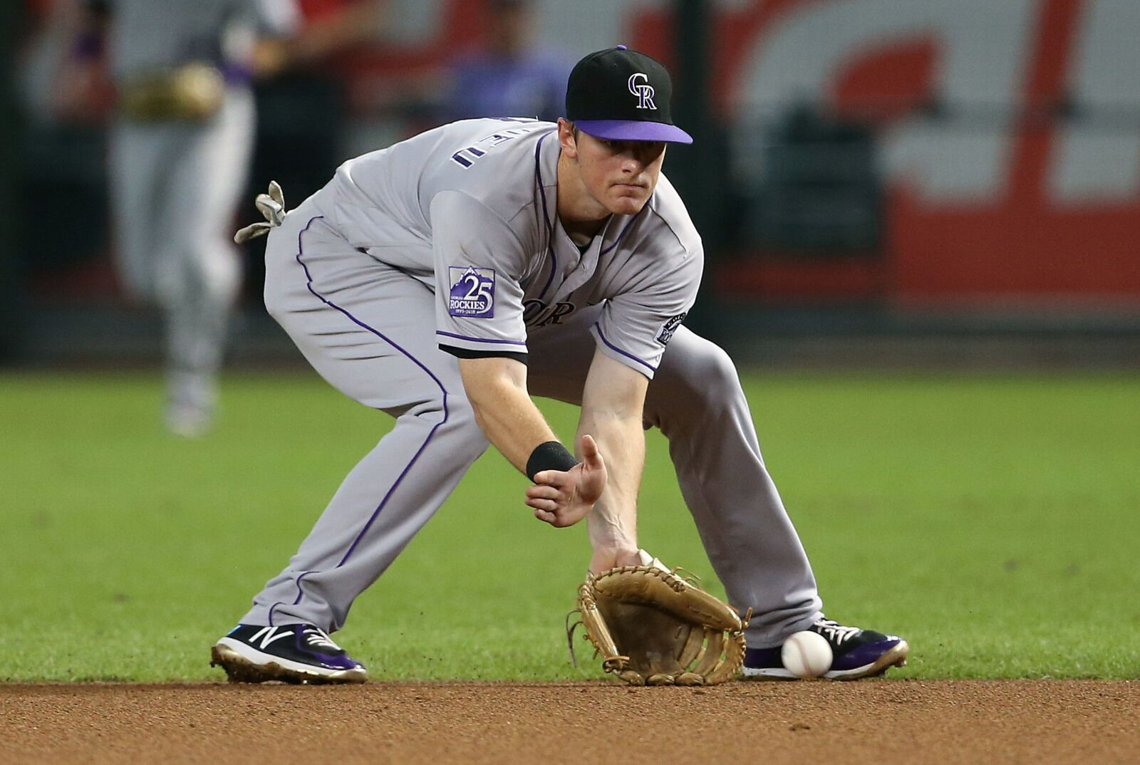 PHOENIX, AZ - SEPTEMBER 22: Second baseman DJ LeMahieu #9 of the Colorado Rockies fields a ground ball against the Arizona Diamondbacks during the first inning of an MLB game at Chase Field on September 22, 2018 in Phoenix, Arizona. (Photo by Ralph Freso/Getty Images)
