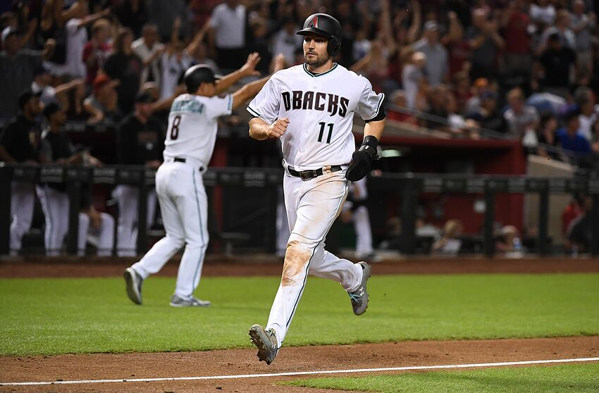 PHOENIX, AZ - SEPTEMBER 25: AJ Pollock #11 of the Arizona Diamondbacks scores a run against the Los Angeles Dodgers at Chase Field on September 25, 2018 in Phoenix, Arizona. (Photo by Norm Hall/Getty Images)