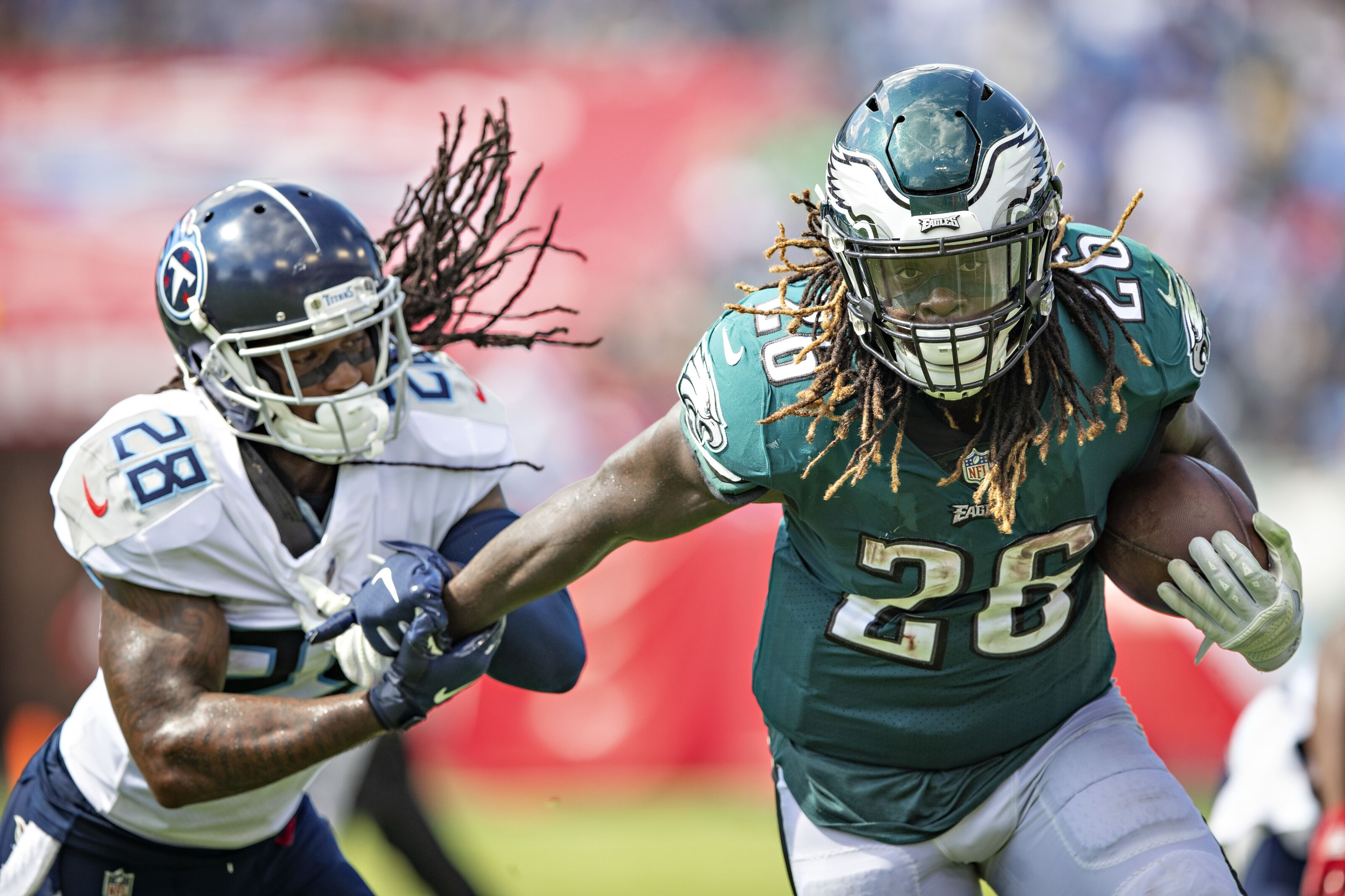 NASHVILLE, TN - SEPTEMBER 30: Jay Ajayi #26 of the Philadelphia Eagles runs the ball and is grabbed by Kendrick Lewis #28 of the Tennessee Titans at Nissan Stadium on September 30, 2018 in Nashville, Tennessee. The Titans defeated the Eagles in overtime 26-23. (Photo by Wesley Hitt/Getty Images)