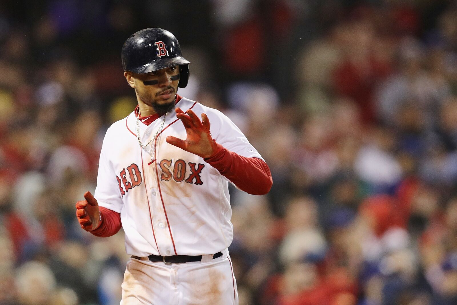 BOSTON, MA - OCTOBER 23: Mookie Betts #50 of the Boston Red Sox reacts after scoring a fifth inning run against the Los Angeles Dodgers in Game One of the 2018 World Series at Fenway Park on October 23, 2018 in Boston, Massachusetts. (Photo by Maddie Meyer/Getty Images)