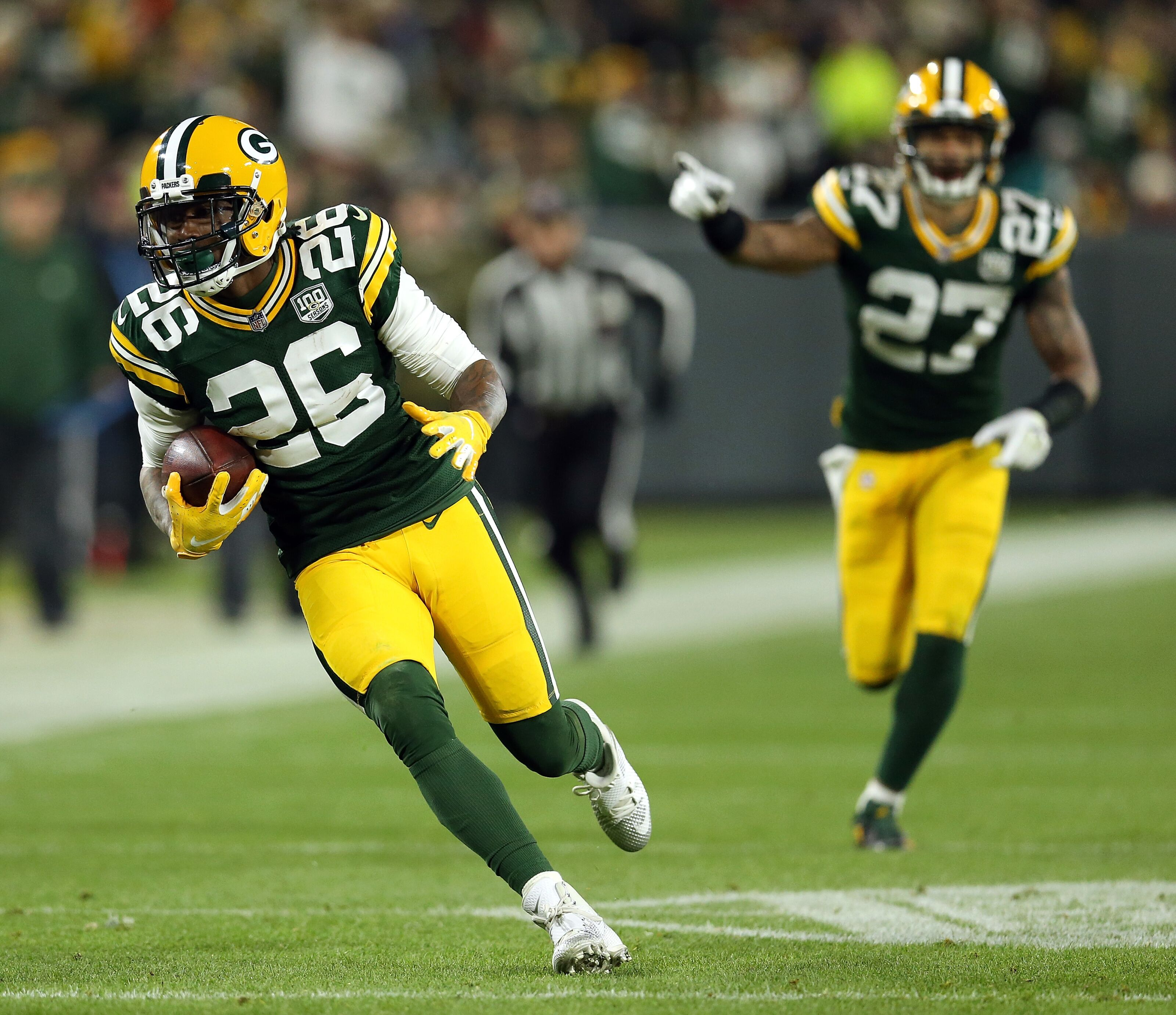 GREEN BAY, WI - NOVEMBER 11: Bashaud Breeland #26 of the Green Bay Packers runs with the ball after intercepting a pass during the second half of a game against the Miami Dolphins at Lambeau Field on November 11, 2018 in Green Bay, Wisconsin. (Photo by Dylan Buell/Getty Images)