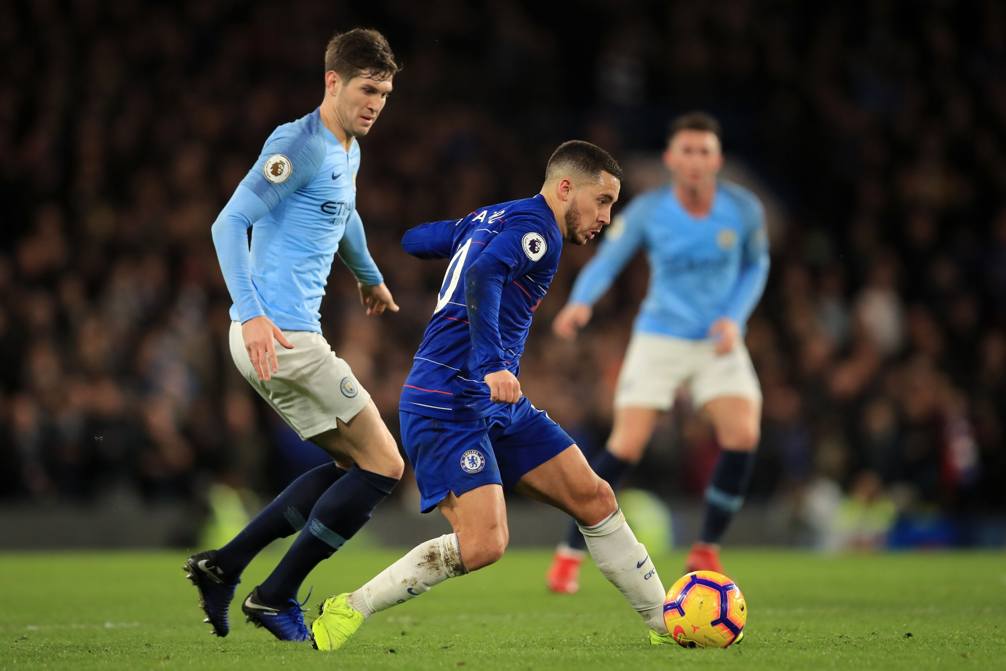 LONDON, ENGLAND - DECEMBER 08: Eden Hazard of Chelsea in action with John Stones of Manchester City during the Premier League match between Chelsea FC and Manchester City at Stamford Bridge on December 8, 2018 in London, United Kingdom. (Photo by Marc Atkins/Offside/Getty Images)