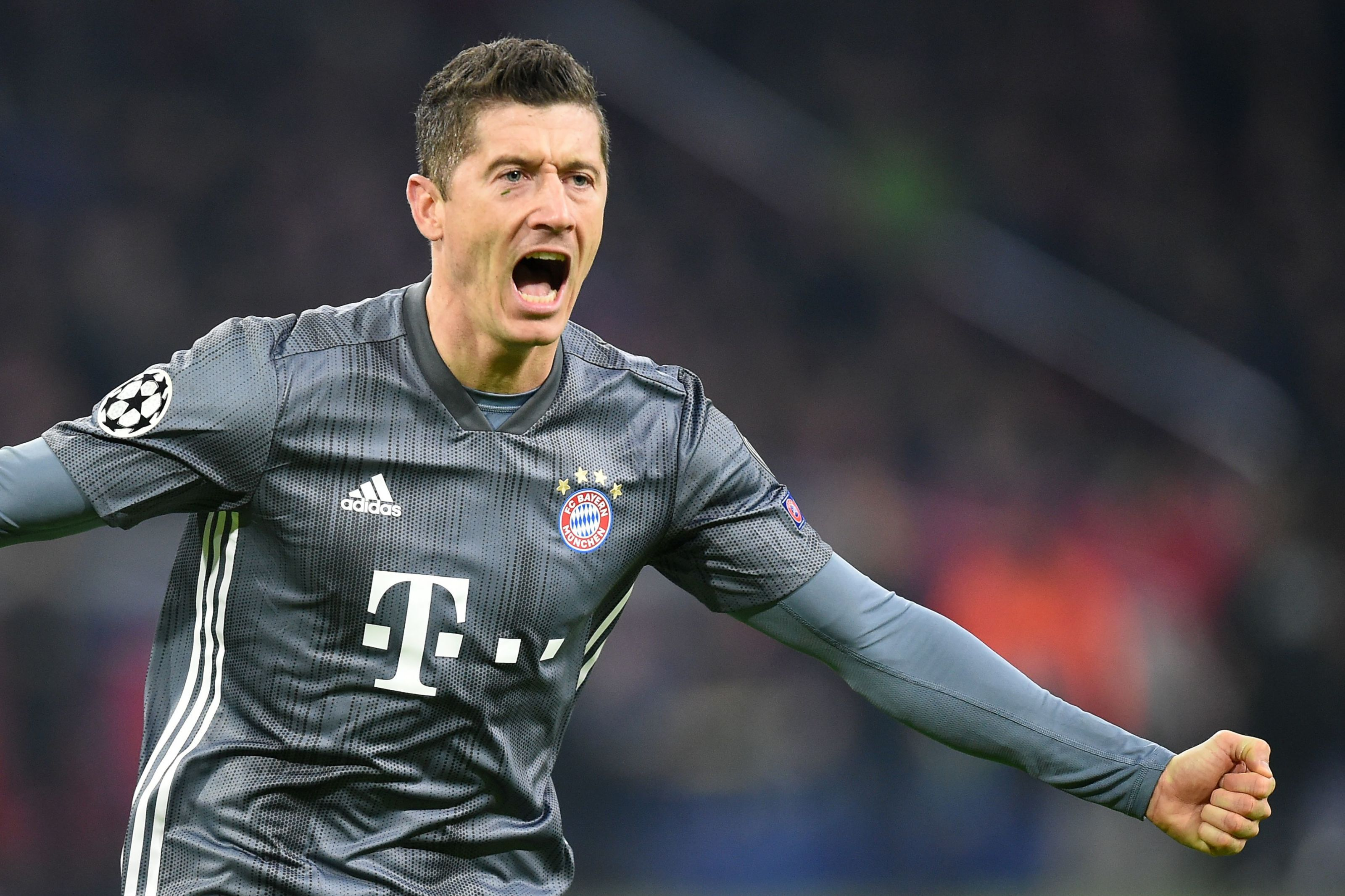 Bayern Munich's Polish forward Robert Lewandowski celebrates after scoring their second goal during the UEFA Champions League Group E football match between AFC Ajax and FC Bayern Munchen at the Johan Cruyff Arena in Amsterdam on December 12, 2018. (Photo by JOHN THYS / AFP) (Photo credit should read JOHN THYS/AFP/Getty Images)