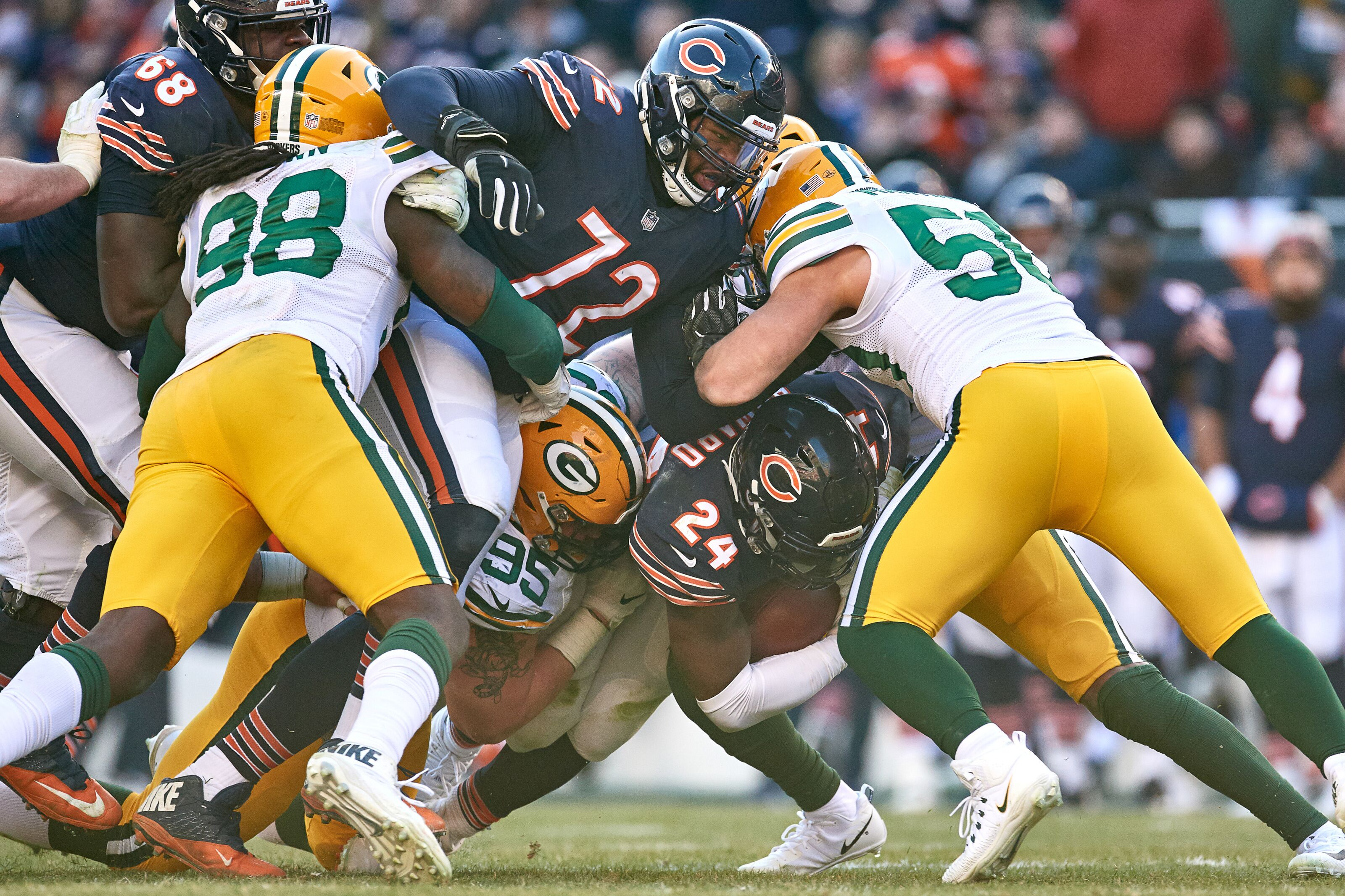 CHICAGO, IL - DECEMBER 16: Green Bay Packers defensive tackle Tyler Lancaster (95) and Green Bay Packers inside linebacker Blake Martinez (50) tackles Chicago Bears running back Jordan Howard (24) in action during an NFL game between the Green Bay Packers and the Chicago Bears on December 16, 2018 at Soldier Field in Chicago, IL. (Photo by Robin Alam/Icon Sportswire via Getty Images)