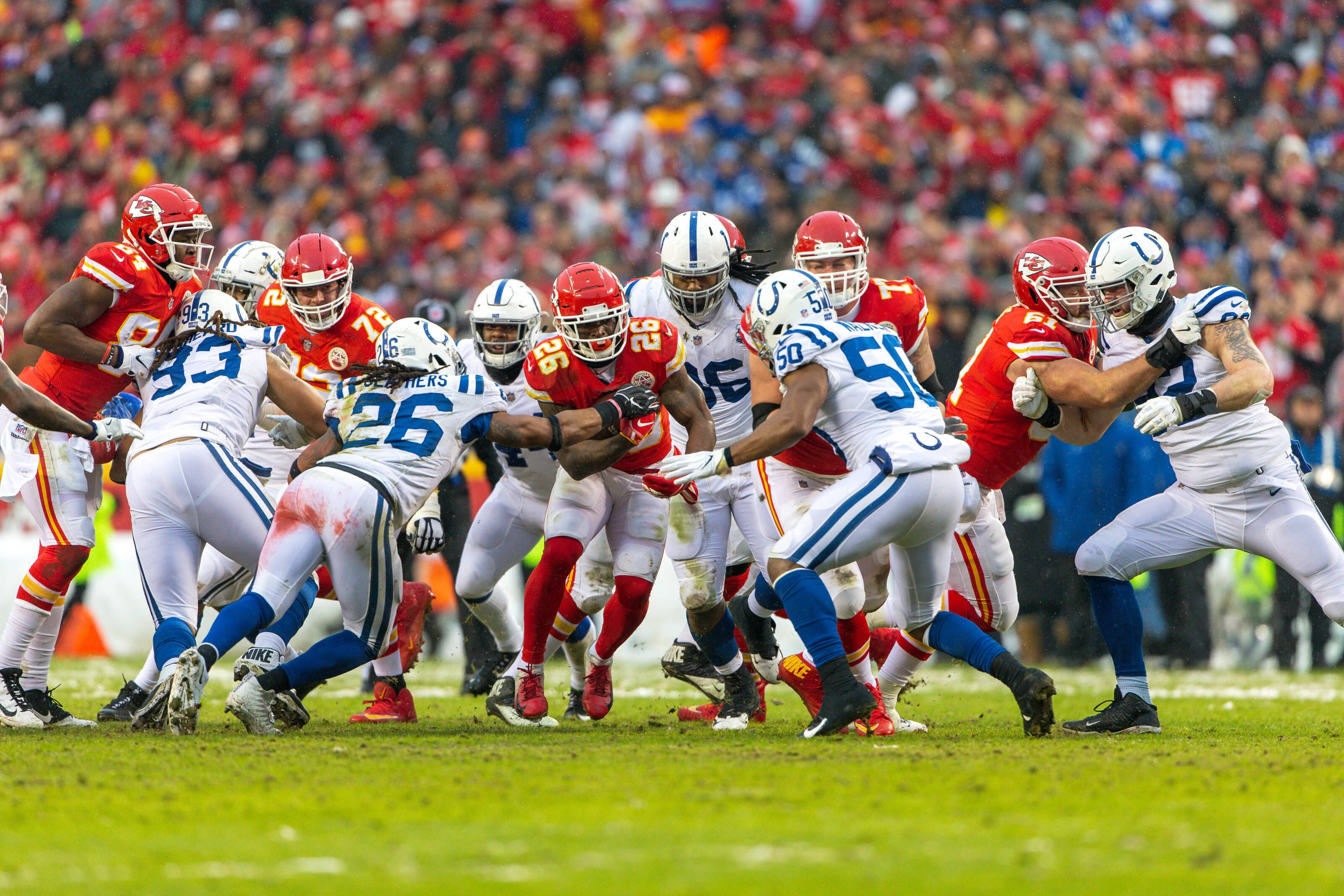KANSAS CITY, MO - JANUARY 12: Kansas City Chiefs running back Damien Williams (26) looks for an opening during the NFL AFC Divisional Round playoff game against the Indianapolis Colts on January 12, 2019 at Arrowhead Stadium in Kansas City, Missouri. (Photo by William Purnell/Icon Sportswire via Getty Images)