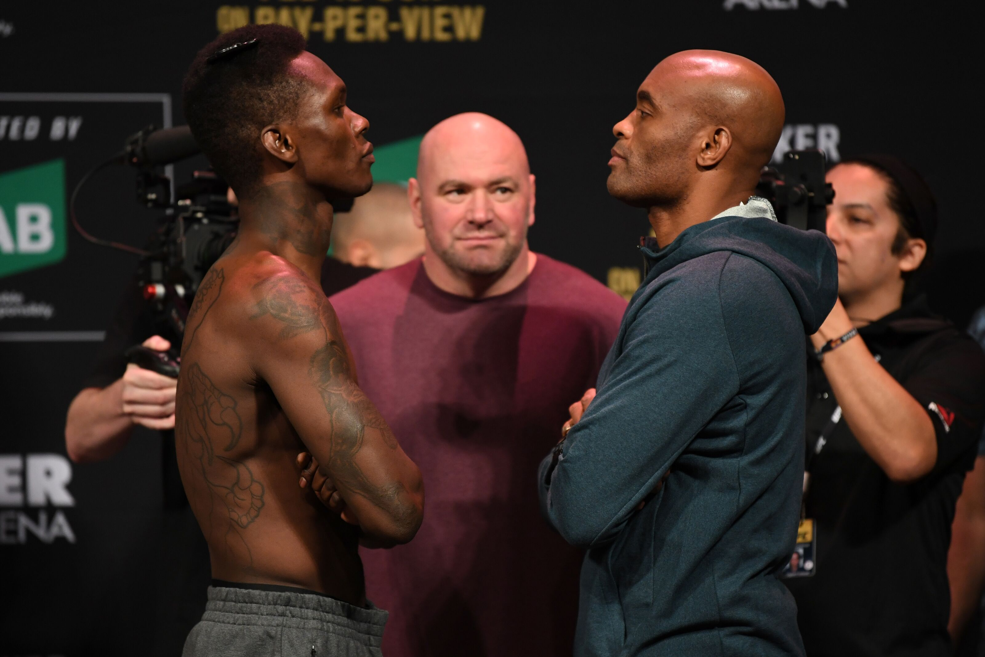 MELBOURNE, AUSTRALIA - FEBRUARY 09: (L-R) Israel Adesanya of New Zealand and Anderson Silva of Brazil face off during the UFC 234 weigh-in at Rod Laver Arena on February 09, 2019 in the Melbourne Australia. (Photo by Jeff Bottari/Zuffa LLC/Zuffa LLC via Getty Images)