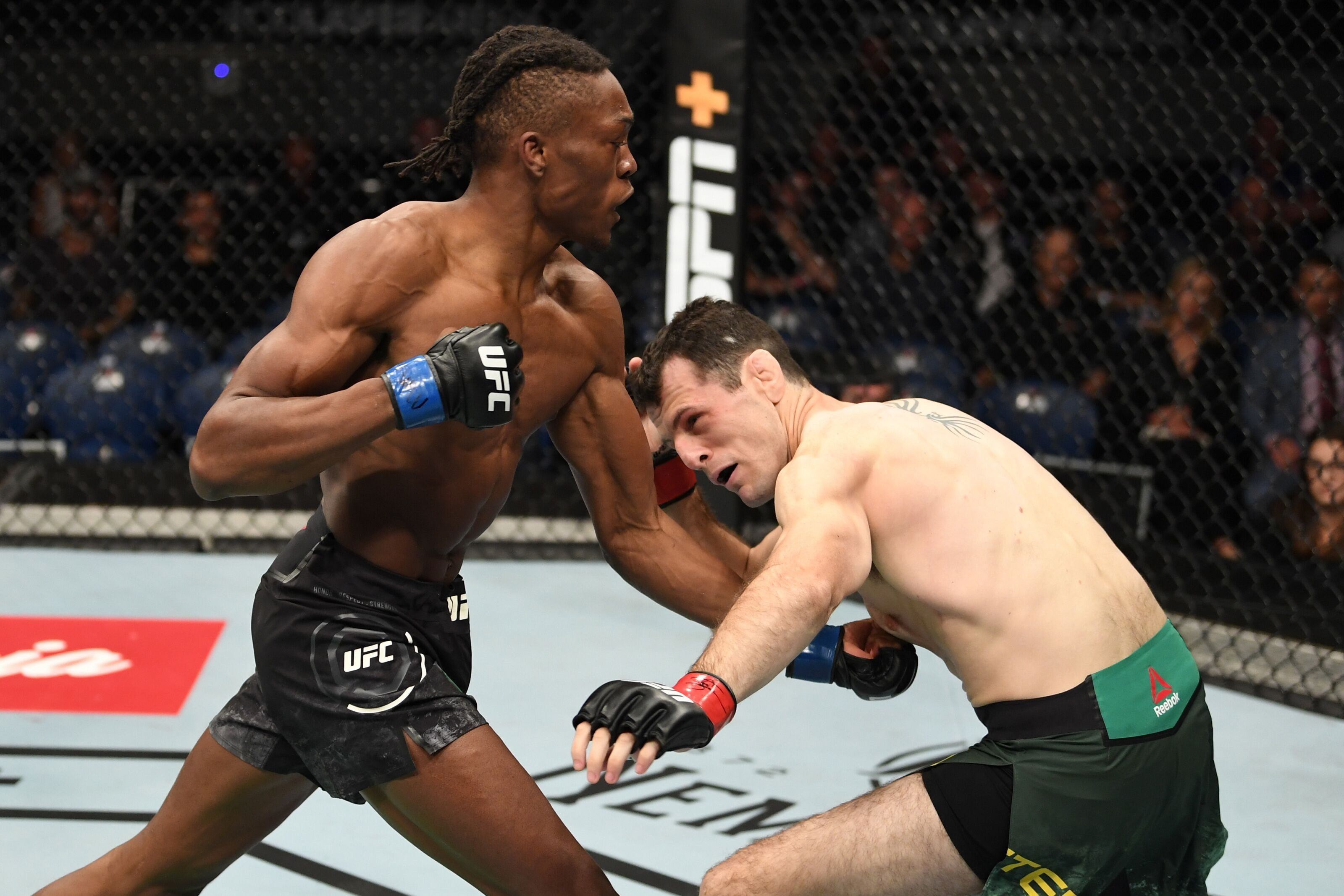 MELBOURNE, AUSTRALIA - FEBRUARY 10: (L-R) Jalin Turner punches Callan Potter of Australia in their lightweight bout during the UFC 234 at Rod Laver Arena on February 10, 2019 in the Melbourne, Australia. (Photo by Jeff Bottari/Zuffa LLC/Zuffa LLC via Getty Images)