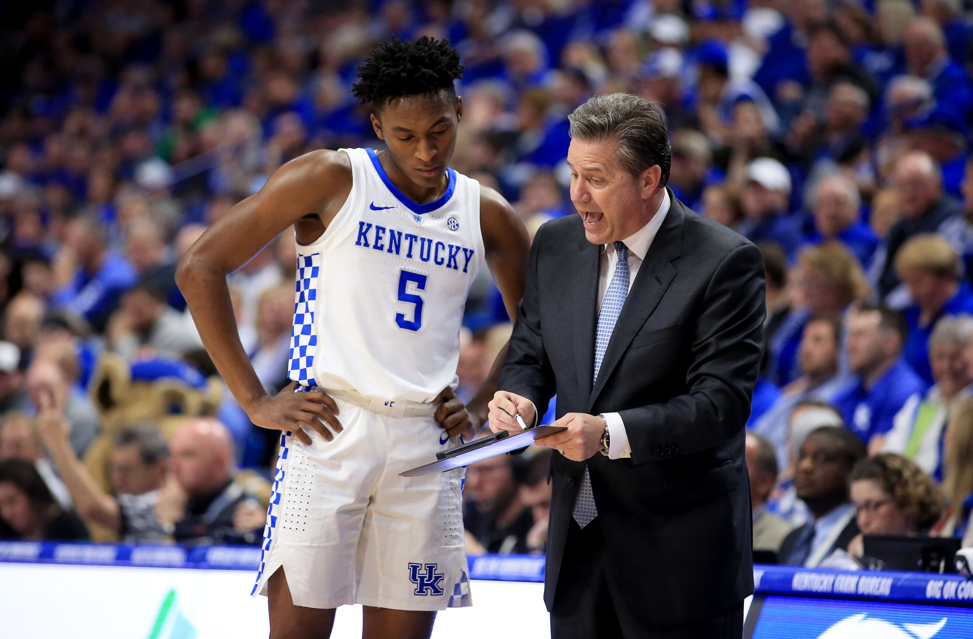 LEXINGTON, KENTUCKY - FEBRUARY 05: Immanuel Quickley #5 of the Kentucky Wildcats and head coach John Calipari discuss a play against the South Carolina Gamecocks at Rupp Arena on February 05, 2019 in Lexington, Kentucky. (Photo by Andy Lyons/Getty Images)
