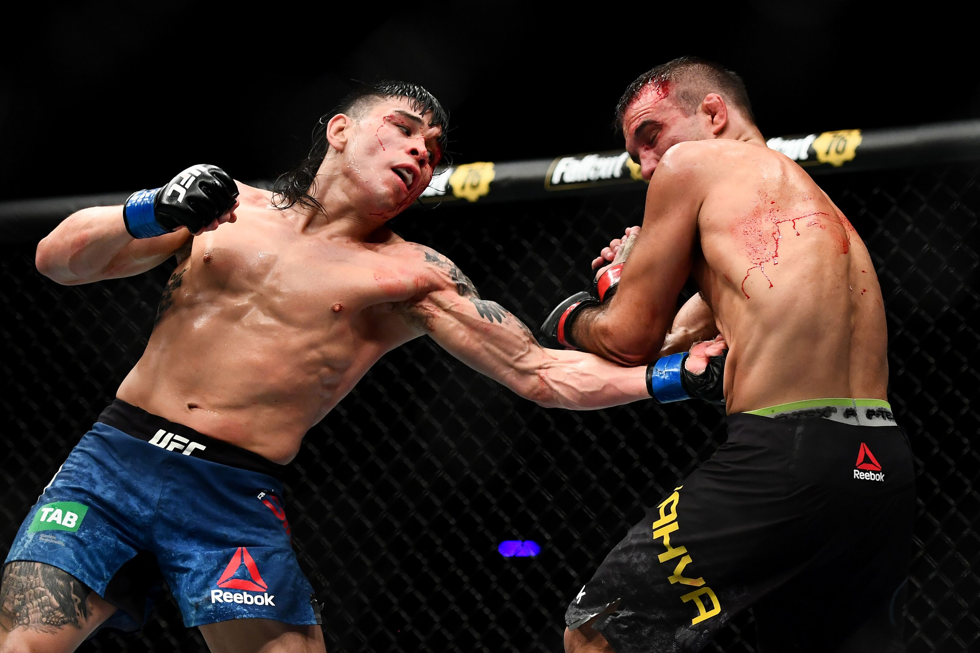 MELBOURNE, AUSTRALIA - FEBRUARY 10: Ricky Simon of the United States punches Rani Yahya of Brazil during their Bantamweight bout during UFC234 at Rod Laver Arena on February 10, 2019 in Melbourne, Australia. (Photo by Quinn Rooney/Getty Images)