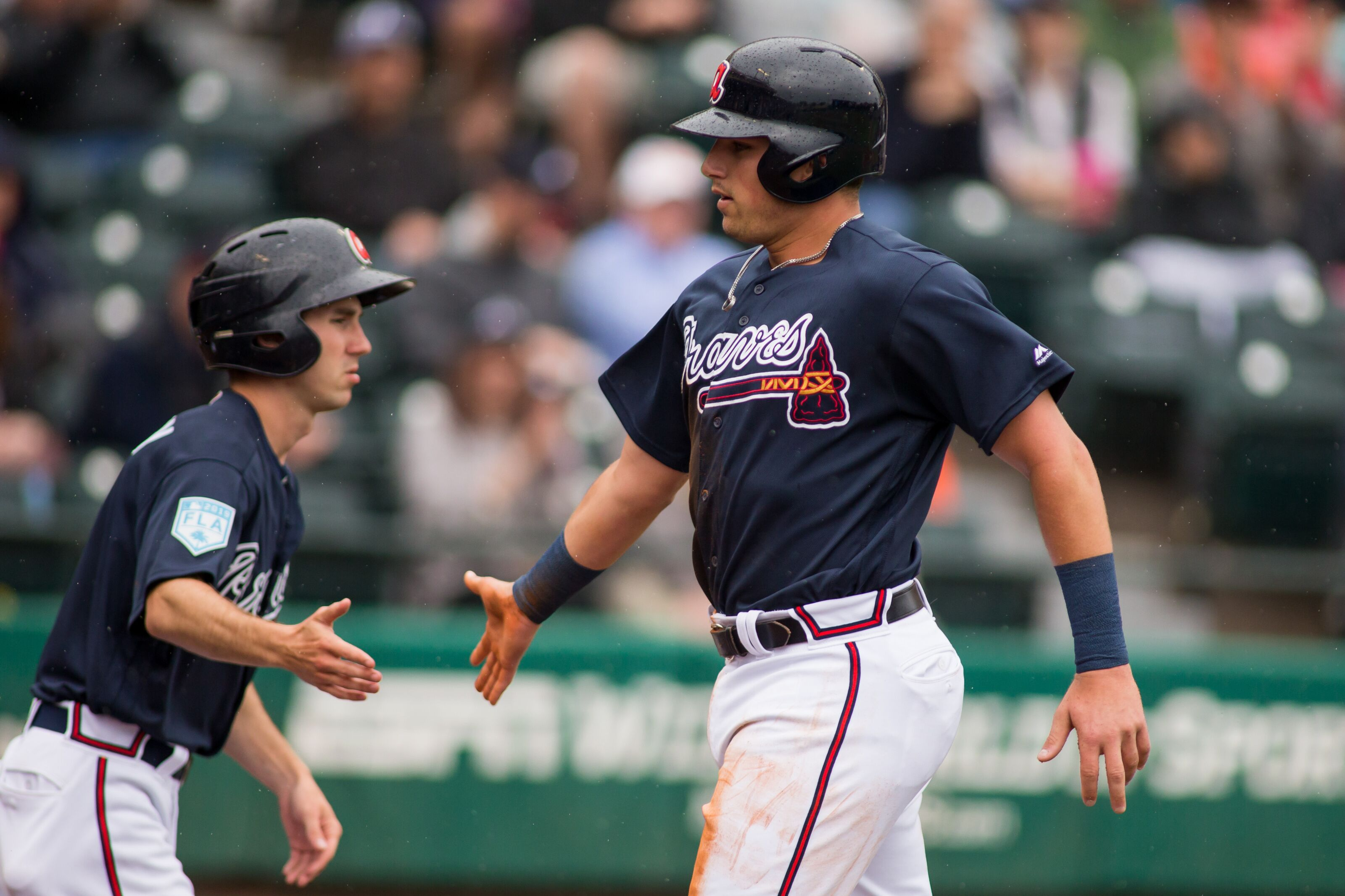 LAKE BUENA VISTA, FL - MARCH 19: Atlanta Braves third baseman Austin Riley (74) celebrates after scoring in the third inning of a Major League Baseball spring training game between the Washington Nationals and the Atlanta Braves at Champion Stadium in Lake Buena Vista, FL on March 19. (Photo by Mary Holt/Icon Sportswire via Getty Images)