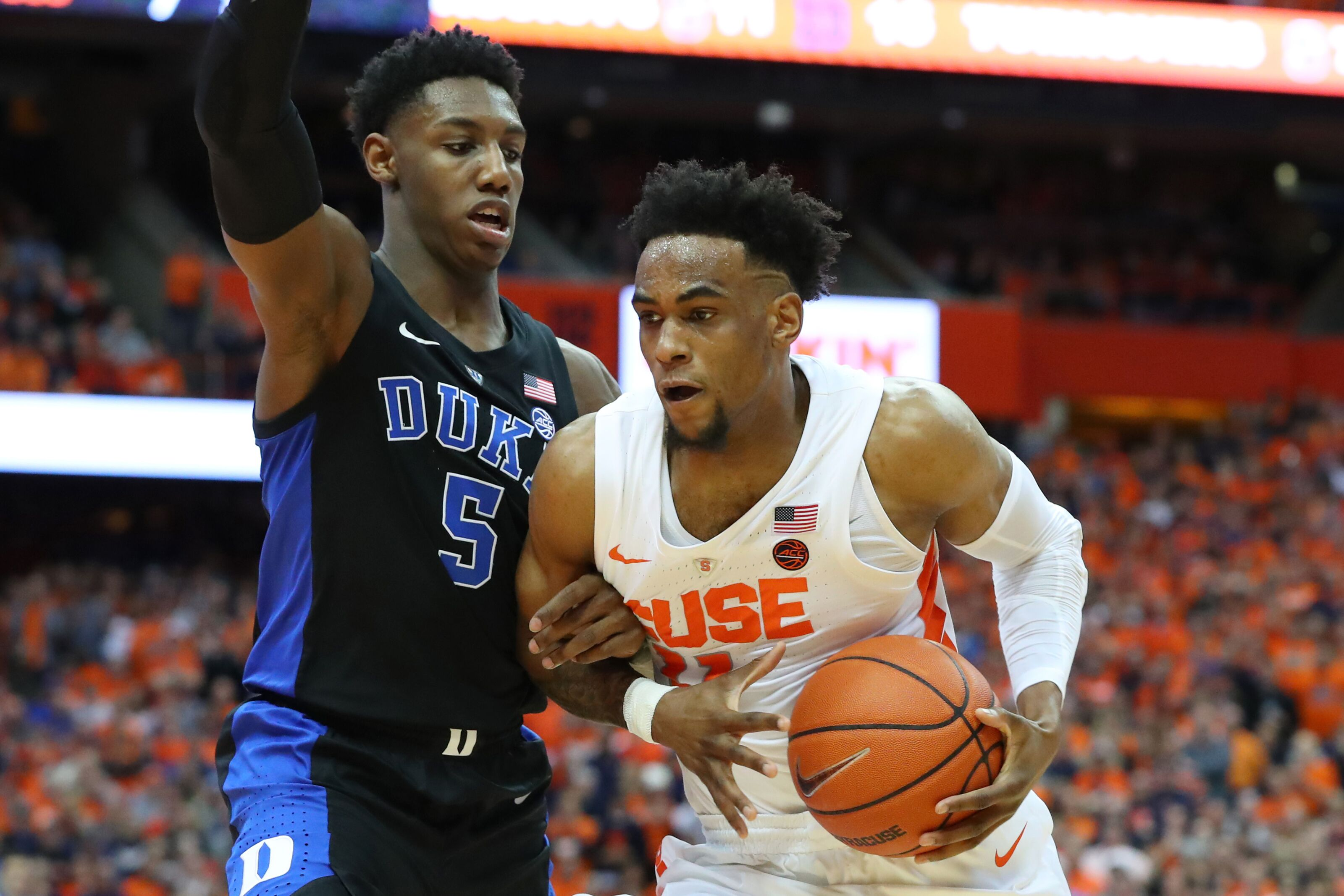 SYRACUSE, NY - FEBRUARY 23: Oshae Brissett #11 of the Syracuse Orange drives to the basket while tangled up with RJ Barrett #5 of the Duke Blue Devils during the second half at the Carrier Dome on February 23, 2019 in Syracuse, New York. Duke defeated Syracuse 75-65. (Photo by Rich Barnes/Getty Images)