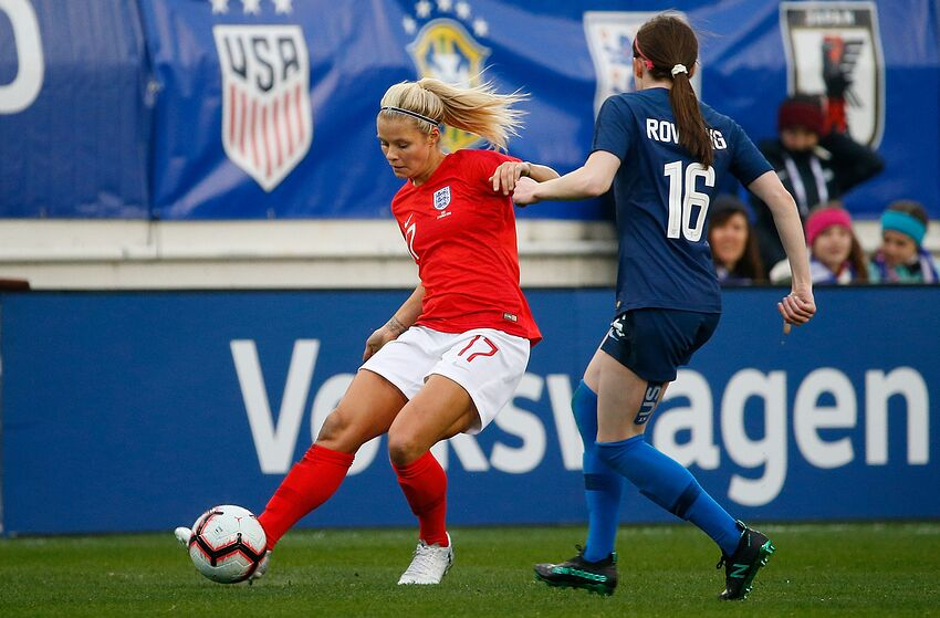 NASHVILLE, TN - MARCH 02: Rose Lavelle #16 of the USA plays against Rachel Daley #17 of England during the second half of the 2019 SheBelieves Cup match between USA and England at Nissan Stadium on March 2, 2019 in Nashville, Tennessee. The U.S. Women's National Team are wearing the names of iconic and influential women on the back of their jerseys. (J.K. Rowling) (Photo by Frederick Breedon/Getty Images)