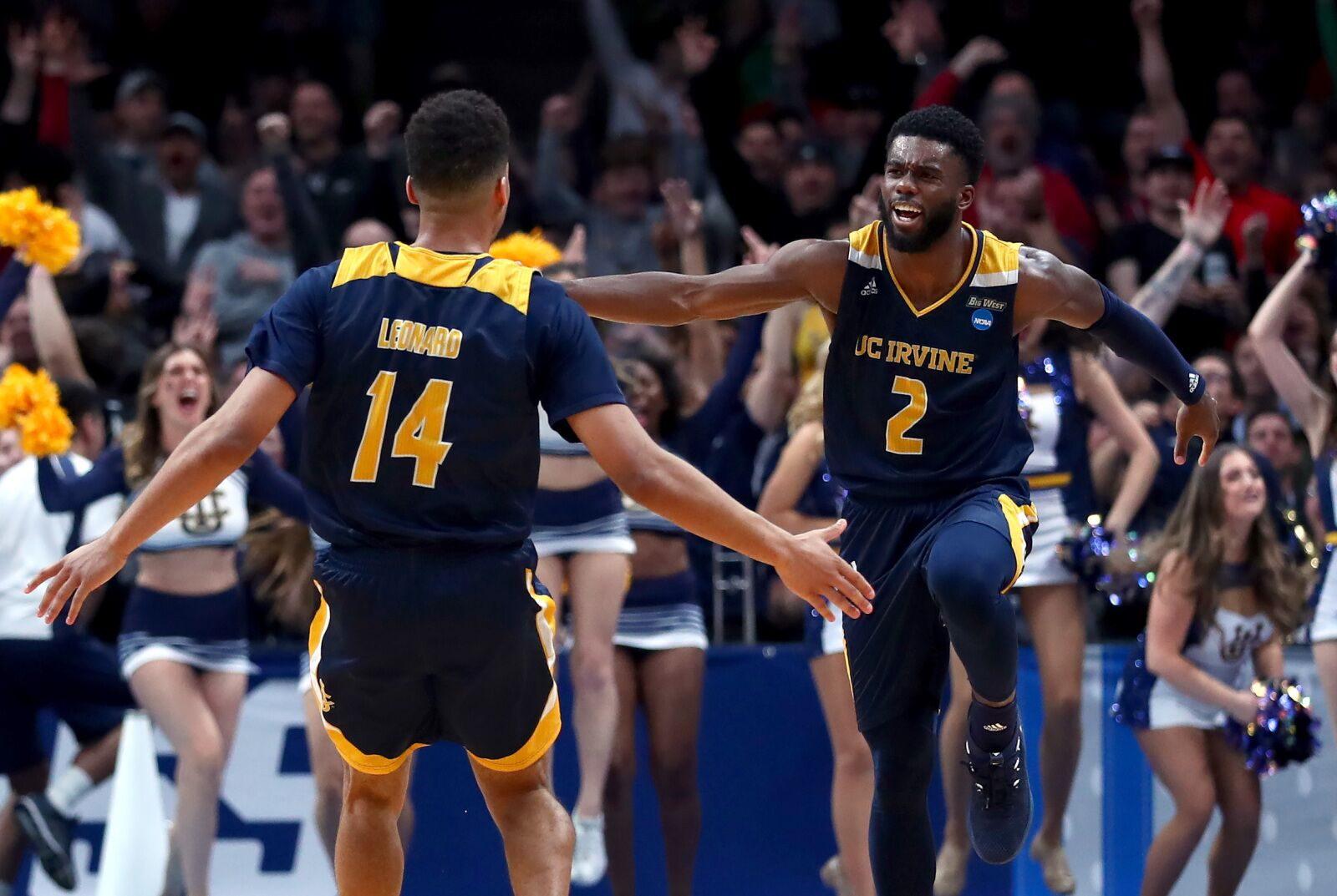 SAN JOSE, CALIFORNIA - MARCH 22: Evan Leonard #14 of the UC Irvine Anteaters celebrates a three-point shot with Max Hazzard #2 in the second half against the Kansas State Wildcats during the first round of the 2019 NCAA Men's Basketball Tournament at SAP Center on March 22, 2019 in San Jose, California. (Photo by Yong Teck Lim/Getty Images)