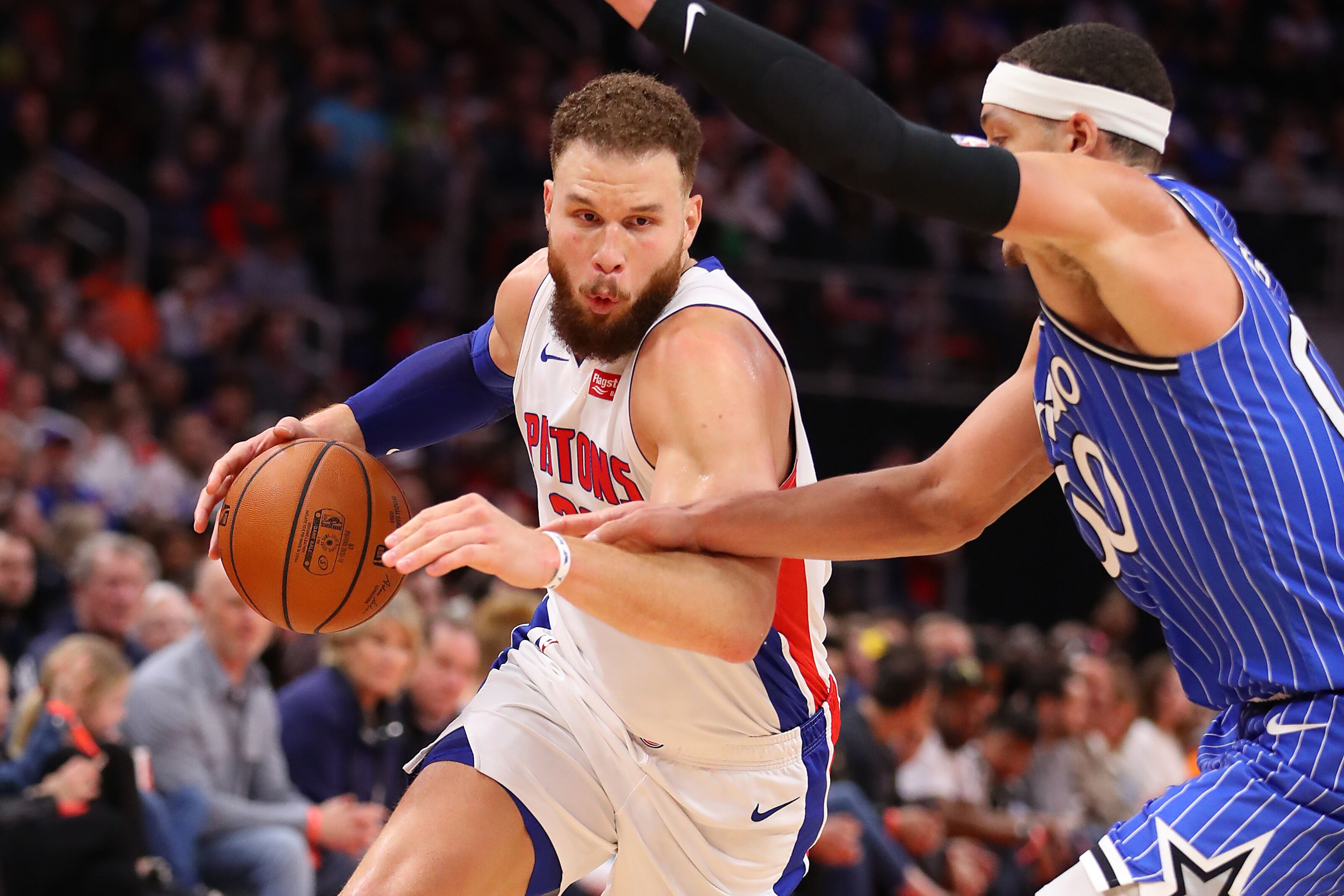 DETROIT, MICHIGAN - MARCH 28: Blake Griffin #23 of the Detroit Pistons drives around Aaron Gordon #00 of the Orlando Magic during the second half at Little Caesars Arena on March 28, 2019 in Detroit, Michigan. Detroit won the game 115-98. NOTE TO USER: User expressly acknowledges and agrees that, by downloading and or using this photograph, User is consenting to the terms and conditions of the Getty Images License Agreement. (Photo by Gregory Shamus/Getty Images)
