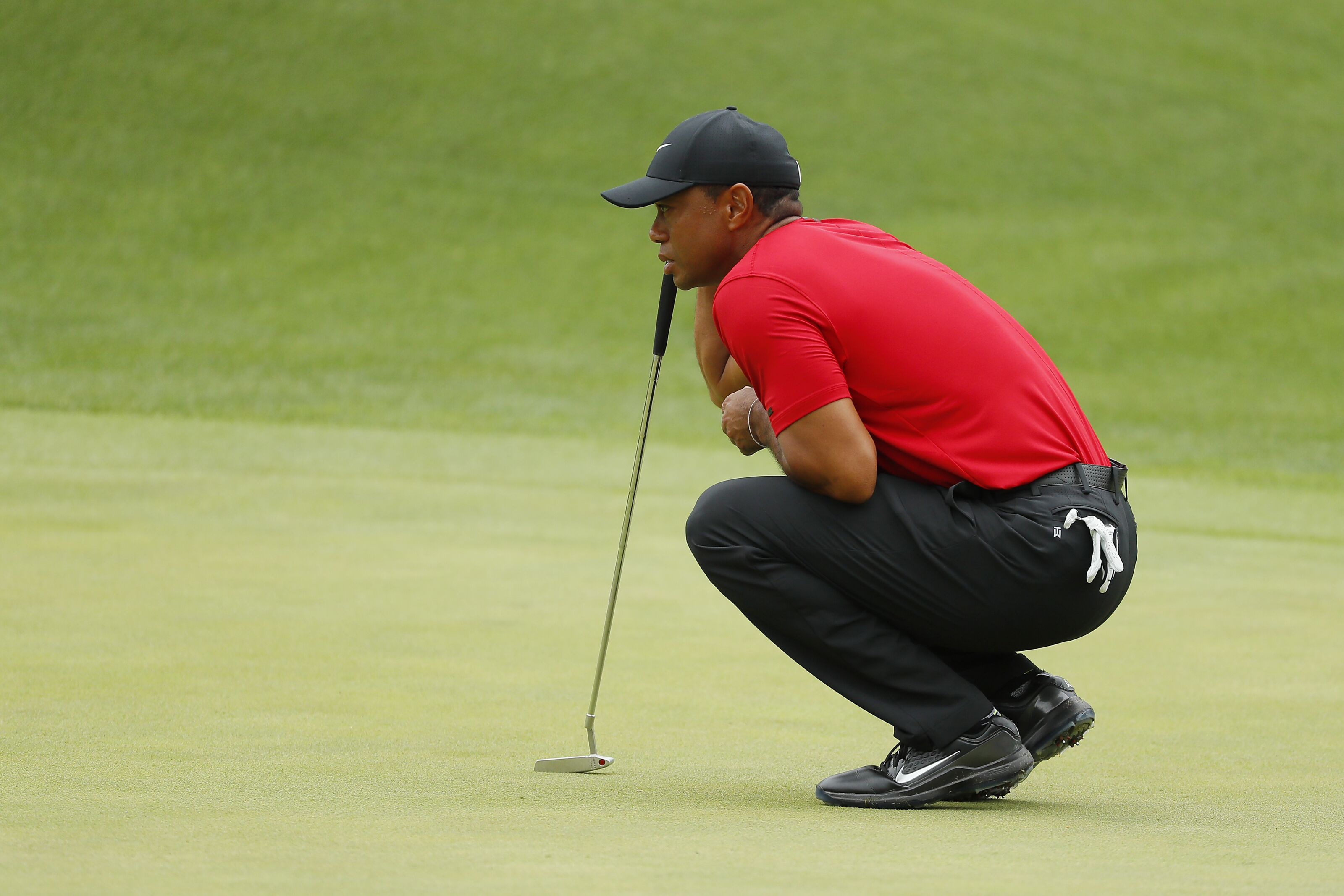 AUGUSTA, GEORGIA - APRIL 14: Tiger Woods of the United States lines up a putt on the eighth green during the final round of the Masters at Augusta National Golf Club on April 14, 2019 in Augusta, Georgia. (Photo by Kevin C. Cox/Getty Images)