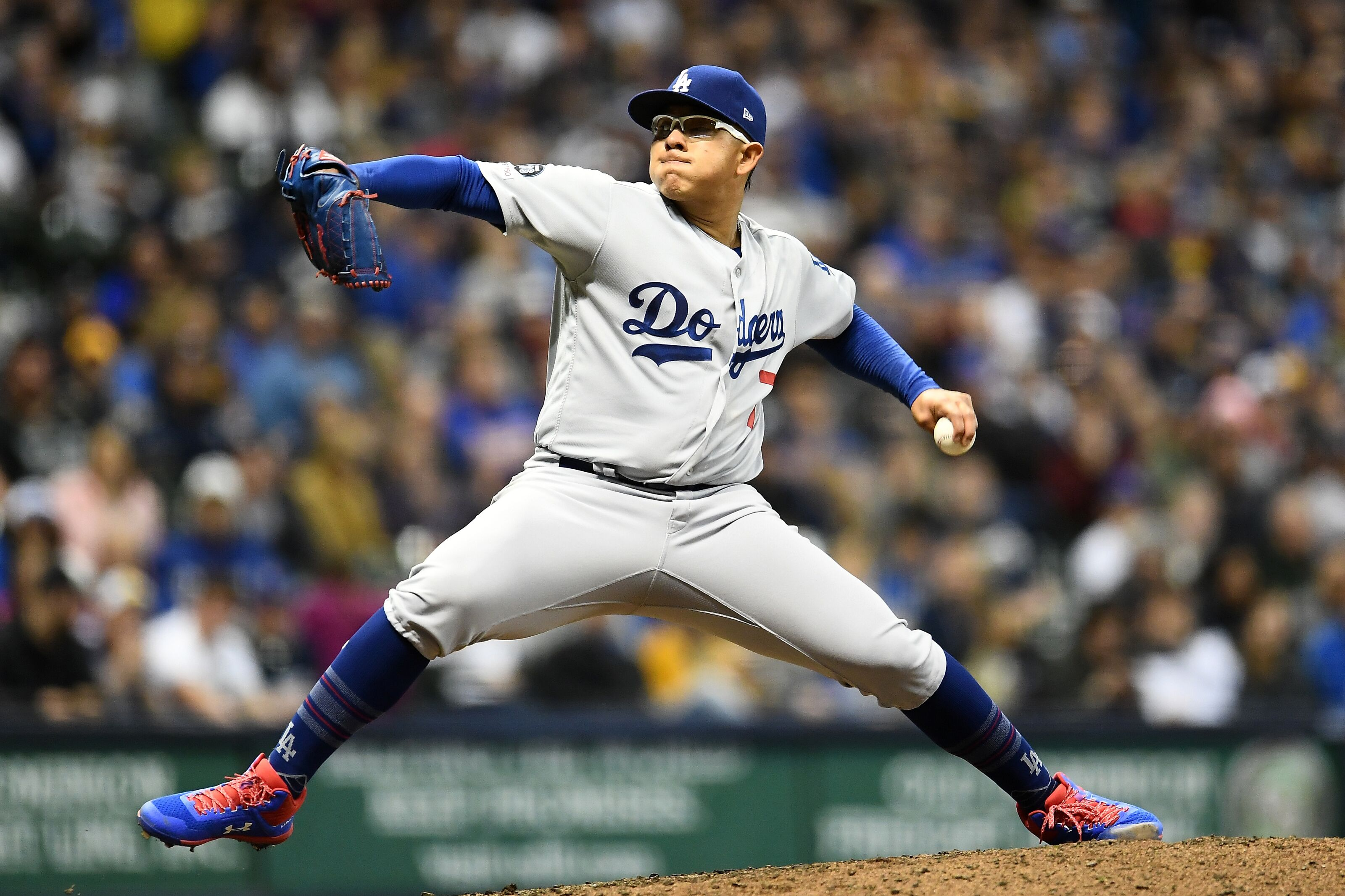 MILWAUKEE, WISCONSIN - APRIL 18: Julio Urias #7 of the Los Angeles Dodgers throws a pitch during a game against the Milwaukee Brewers at Miller Park on April 18, 2019 in Milwaukee, Wisconsin. (Photo by Stacy Revere/Getty Images)