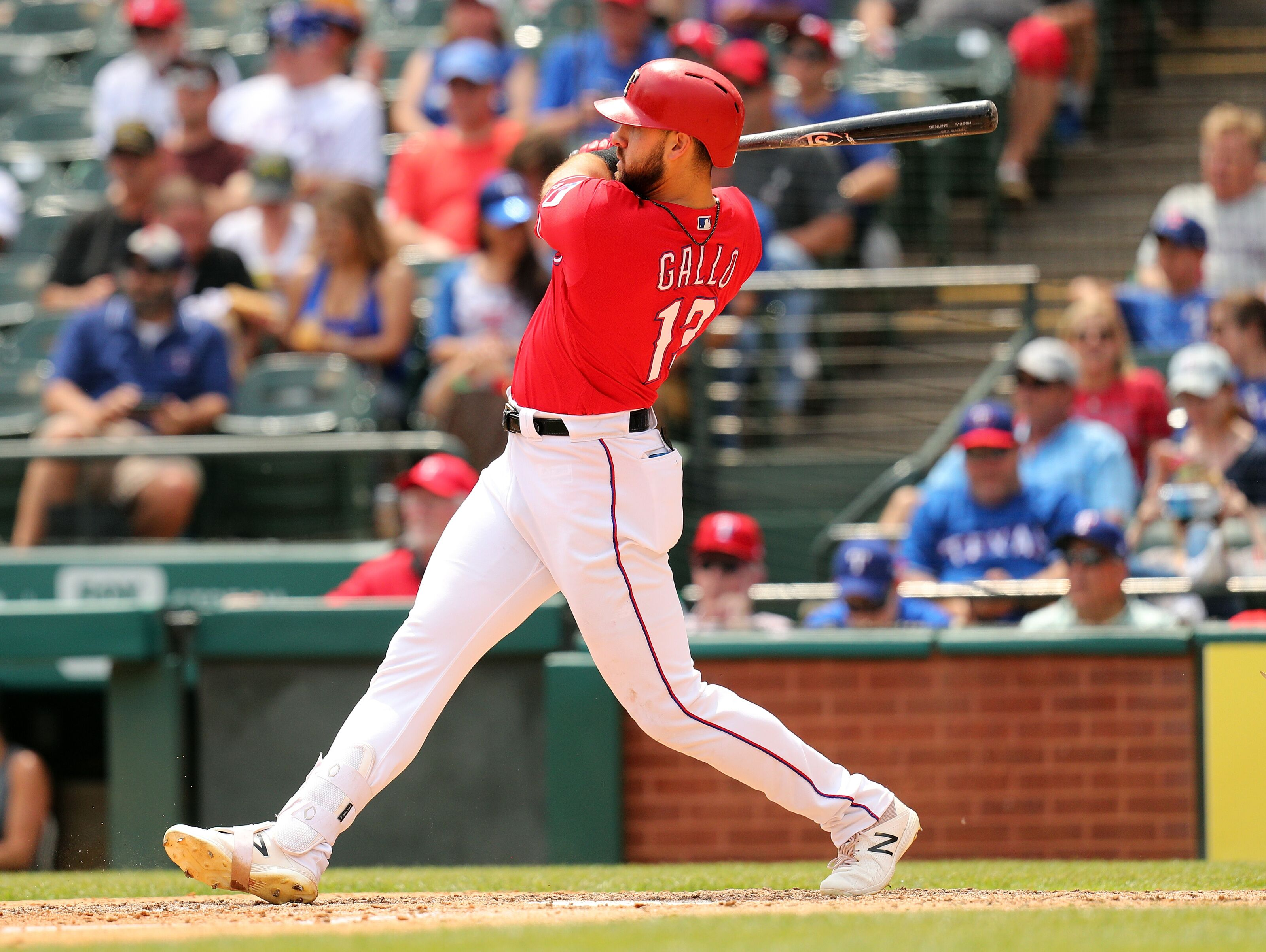 ARLINGTON, TEXAS - MAY 01: Joey Gallo #13 of the Texas Rangers hits a home run in the sixth inning against the Pittsburgh Pirates at Globe Life Park in Arlington on May 01, 2019 in Arlington, Texas. (Photo by Richard Rodriguez/Getty Images)