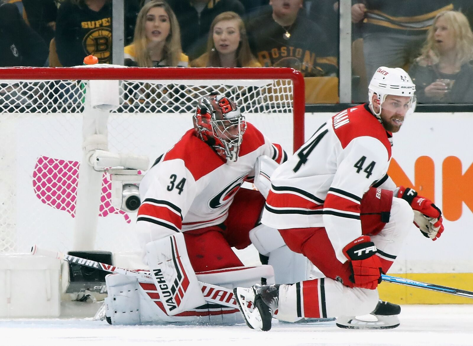 BOSTON, MASSACHUSETTS - MAY 12: Petr Mrazek #34 and Calvin de Haan #44 of the Carolina Hurricanes defend the net against the Boston Bruins in Game Two of the Eastern Conference Final during the 2019 NHL Stanley Cup Playoffs at TD Garden on May 12, 2019 in Boston, Massachusetts. (Photo by Bruce Bennett/Getty Images)