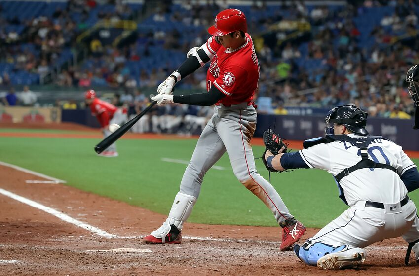 ST. PETERSBURG, FL - JUNE 13: Shohei Ohtani #17 of the Los Angeles Angels connects with a single in front of Mike Zunino #10 of the Tampa Bay Rays in the seventh inning of a baseball game at Tropicana Field on June 13, 2019 in St. Petersburg, Florida. The single complete Ohtani hitting for the cycle in the game. (Photo by Mike Carlson/Getty Images)