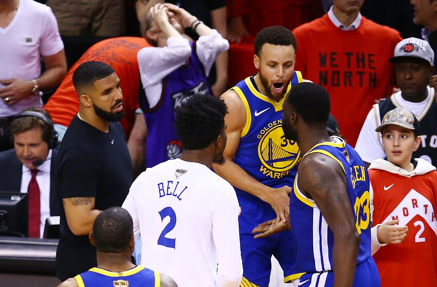 TORONTO, ONTARIO - JUNE 10: Draymond Green #23 and Stephen Curry #30 of the Golden State Warriors celebrate their teams 106-105 win over the Toronto Raptors in Game Five of the 2019 NBA Finals at Scotiabank Arena on June 10, 2019 in Toronto, Canada. NOTE TO USER: User expressly acknowledges and agrees that, by downloading and or using this photograph, User is consenting to the terms and conditions of the Getty Images License Agreement. (Photo by Vaughn Ridley/Getty Images)