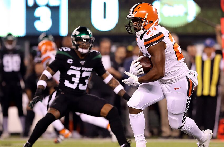 EAST RUTHERFORD, NEW JERSEY - SEPTEMBER 16: Nick Chubb #24 of the Cleveland Browns carries the ball as Jamal Adams #33 of the New York Jets defends at MetLife Stadium on September 16, 2019 in East Rutherford, New Jersey. (Photo by Elsa/Getty Images)