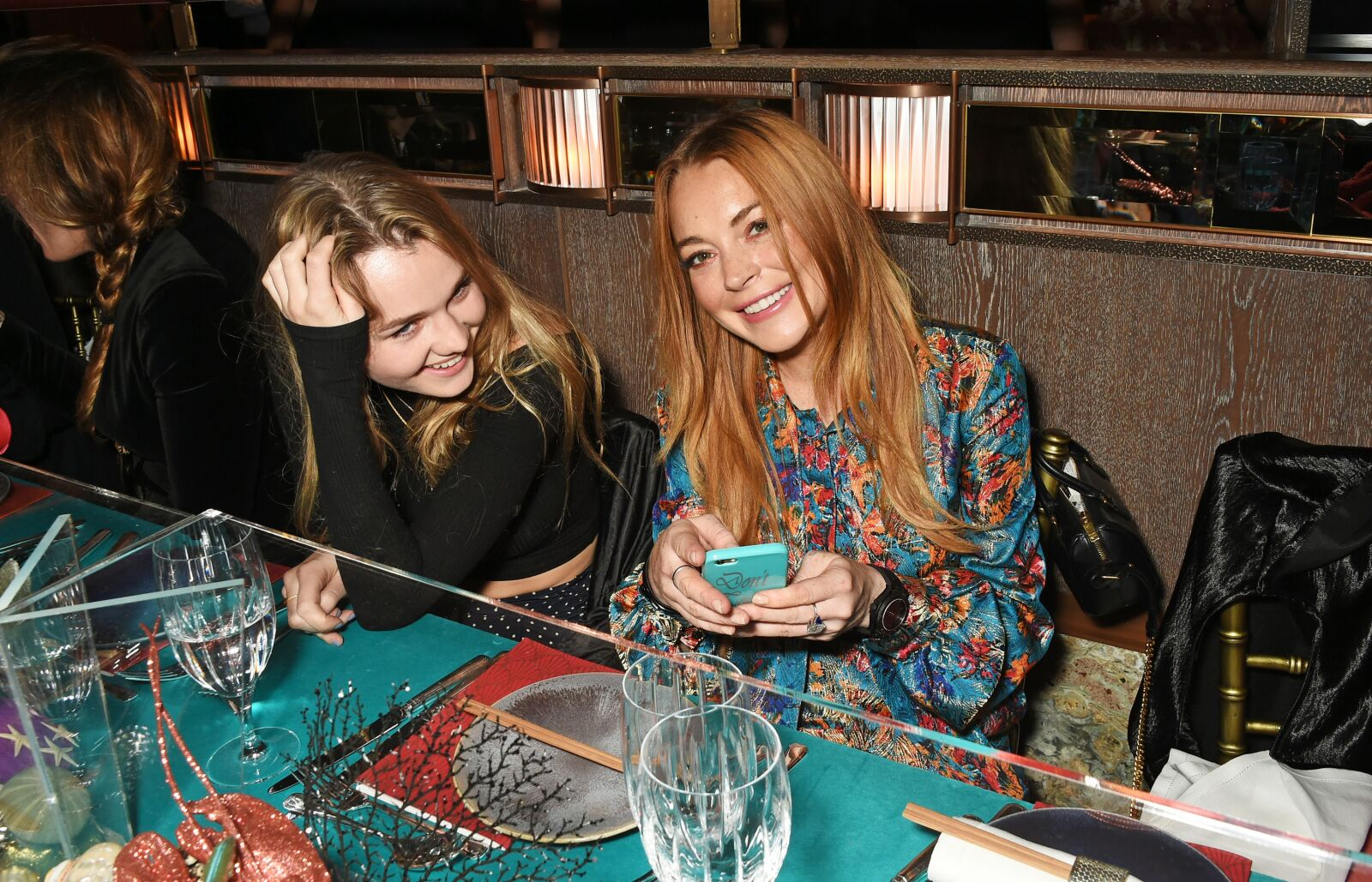 LONDON, ENGLAND - OCTOBER 08: Immy Waterhouse (L) and Lindsay Lohan attend the launch of Sexy Fish, London in Berkeley Square on October 8, 2015 in London, England. (Photo by David M. Benett/Dave Benett/Getty Images for Caprice Holdings Limited)