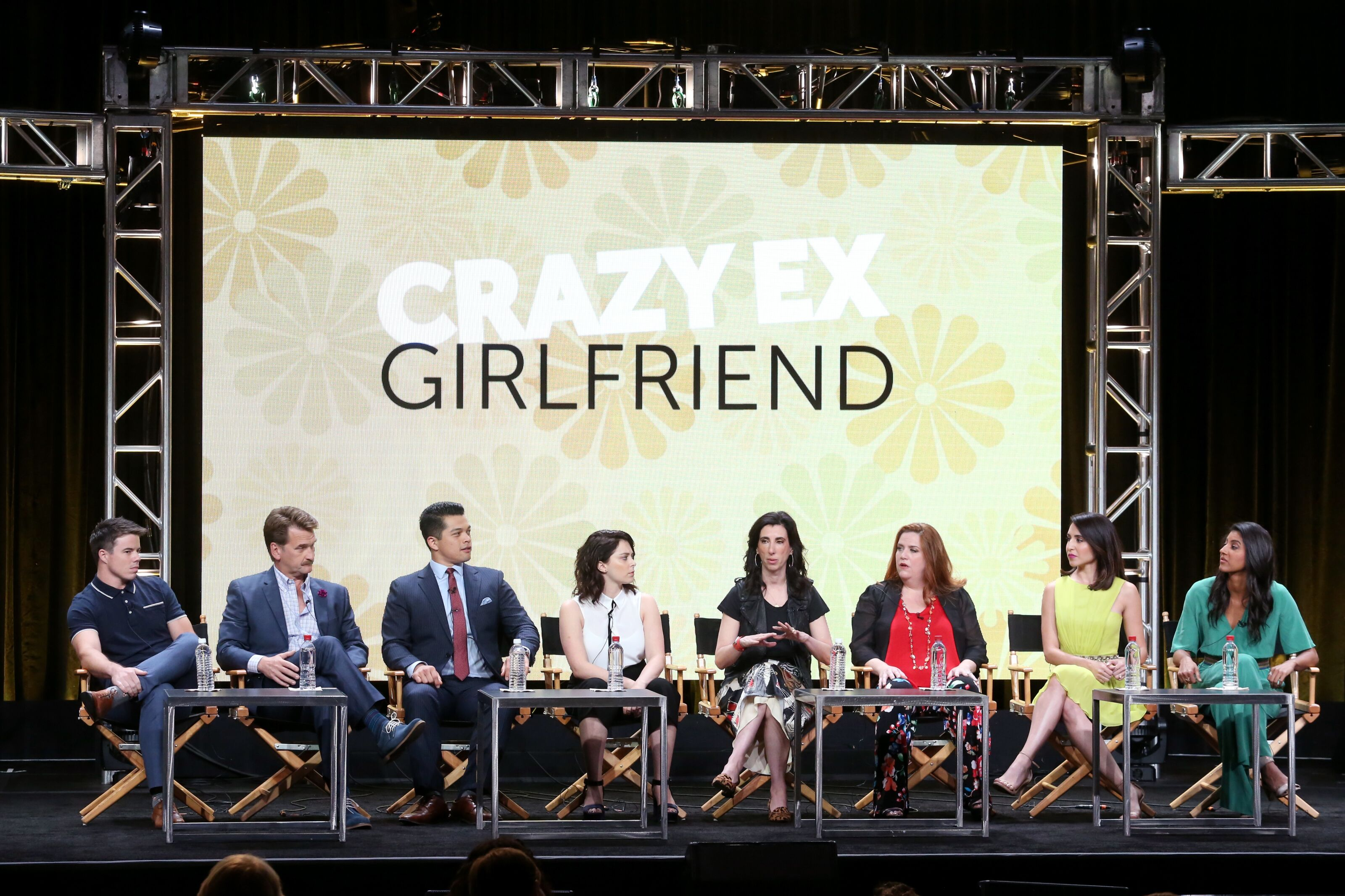 BEVERLY HILLS, CA - AUGUST 02: (L-R) Actors David Hull, Pete Gardner, Vincent Rodriguez III, actor/executive producer Rachel Bloom, executive producer Aline Brosh McKenna, and actors Donna Lynne Champlin, Gabrielle Ruiz, and Vella Lovell of 'Crazy Ex-Girlfriend' speak onstage during the CW portion of the 2017 Summer Television Critics Association Press Tour at The Beverly Hilton Hotel on August 2, 2017 in Beverly Hills, California. (Photo by Frederick M. Brown/Getty Images)