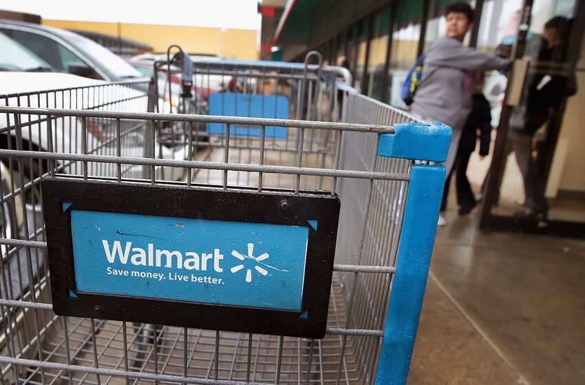 CHICAGO, IL - JANUARY 11: Shopping carts sit outside of a Walmart store on January 11, 2018 in Chicago, Illinois. Walmart announced today it would use savings from the recently revised tax law to increase their starting wage to $11-per-hour, offer some hourly employees a one-time bonus up to $1000, expand maternity and parental leave benefits and will begin to offer adoption assistance. The company also disclosed today that it would be closing 63 of its Sam's Club stores across the US, costing thousands of workers their jobs. (Photo by Scott Olson/Getty Images)