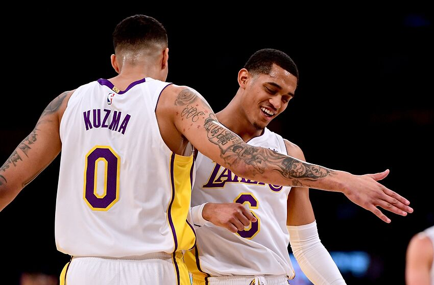 LOS ANGELES, CA - JANUARY 21: Jordan Clarkson #6 of the Los Angeles Lakers celebrates a lead over the New York Knicks with Kyle Kuzma #0 during the first half at Staples Center on January 21, 2018 in Los Angeles, California. (Photo by Harry How/Getty Images)