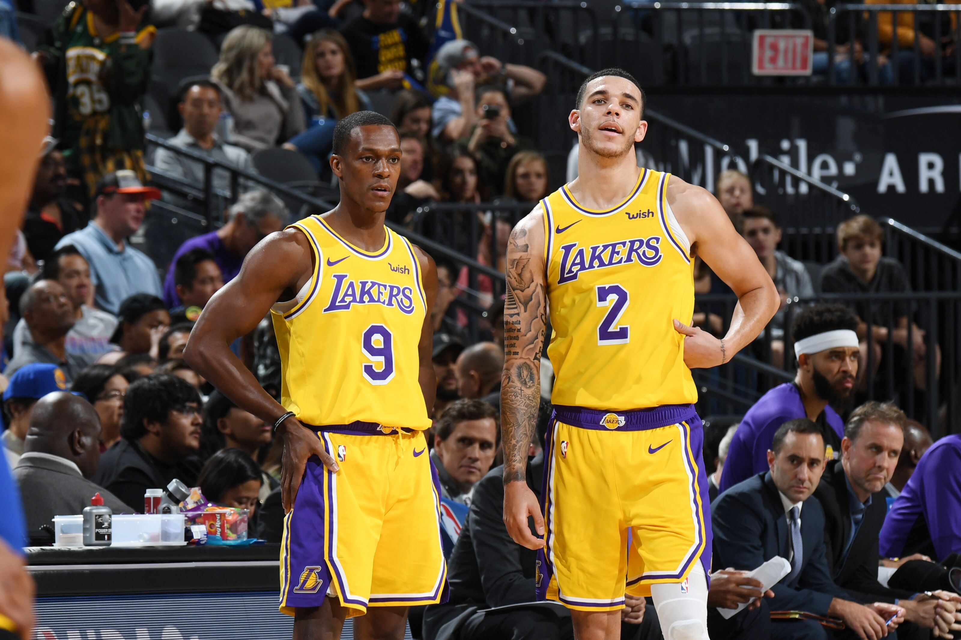 LAS VEGAS, NV- OCTOBER 10: Rajon Rondo #9 and Lonzo Ball #2 of the Los Angeles Lakers look on against the Golden State Warriors during a pre-season game on October 10, 2018 at T-Mobile Arena in Las Vegas, Nevada. NOTE TO USER: User expressly acknowledges and agrees that, by downloading and/or using this Photograph, user is consenting to the terms and conditions of the Getty Images License Agreement. Mandatory Copyright Notice: Copyright 2018 NBAE (Photo by Andrew D. Bernstein/NBAE via Getty Images)