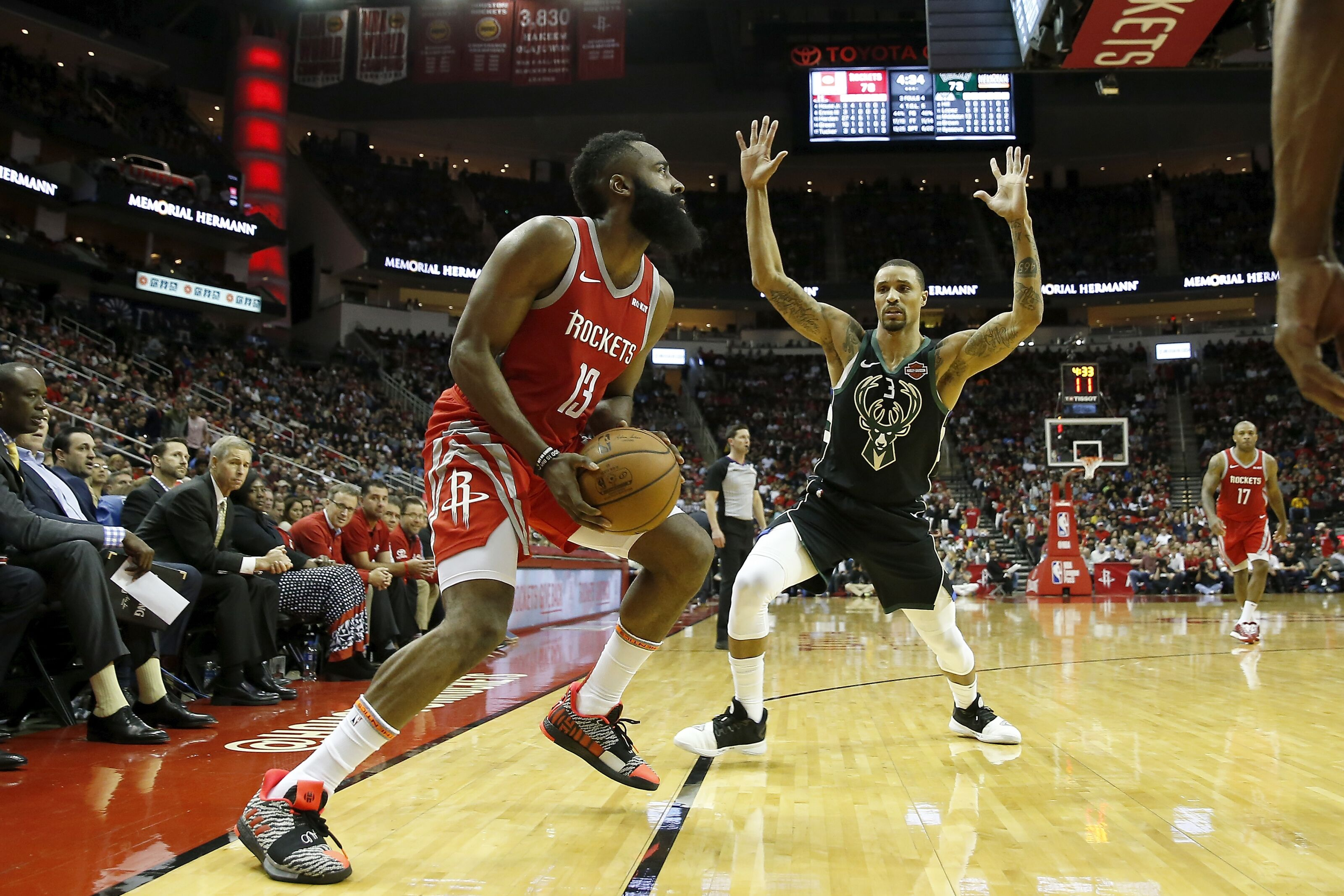 HOUSTON, TX - JANUARY 09: James Harden #13 of the Houston Rockets steps back for a three point shot defended by George Hill #3 of the Milwaukee Bucks in the second half at Toyota Center on January 9, 2019 in Houston, Texas. NOTE TO USER: User expressly acknowledges and agrees that, by downloading and or using this photograph, User is consenting to the terms and conditions of the Getty Images License Agreement. (Photo by Tim Warner/Getty Images)