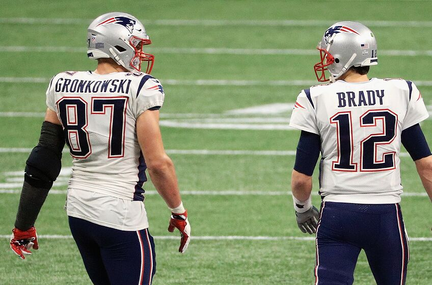 ATLANTA, GA - FEBRUARY 03: Rob Gronkowski #87 of the New England Patriots talks with Tom Brady #12 in the second half during Super Bowl LIII at Mercedes-Benz Stadium on February 3, 2019 in Atlanta, Georgia. (Photo by Mike Ehrmann/Getty Images)