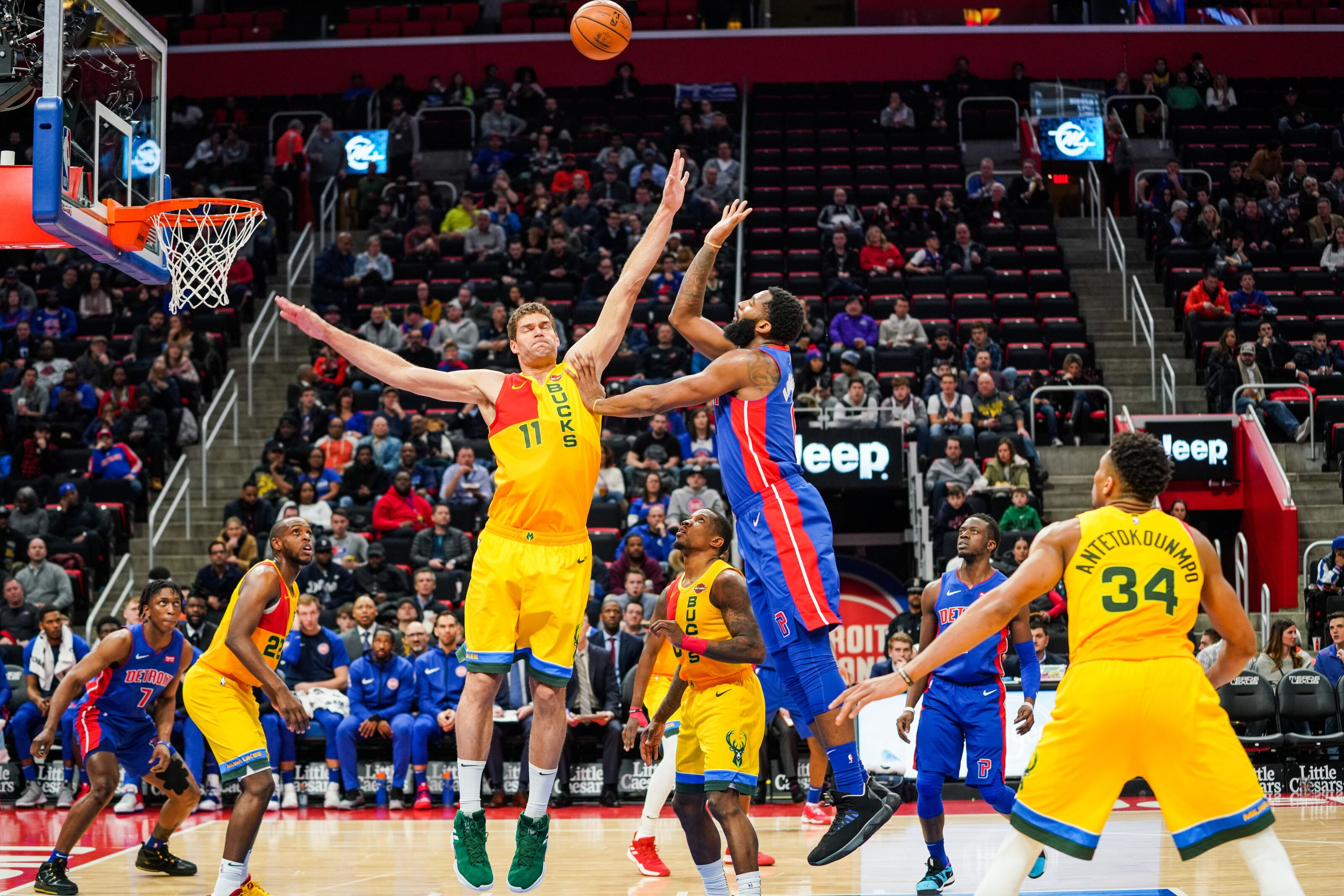 DETROIT, MICHIGAN - JANUARY 29: Andre Drummond #0 of the Detroit Pistons shoots the ball over Brook Lopez #11 of the Milwaukee Bucks during a game at Little Caesars Arena on January 29, 2019 in Detroit, Michigan. (Photo by Cassy Athena/Getty Images)