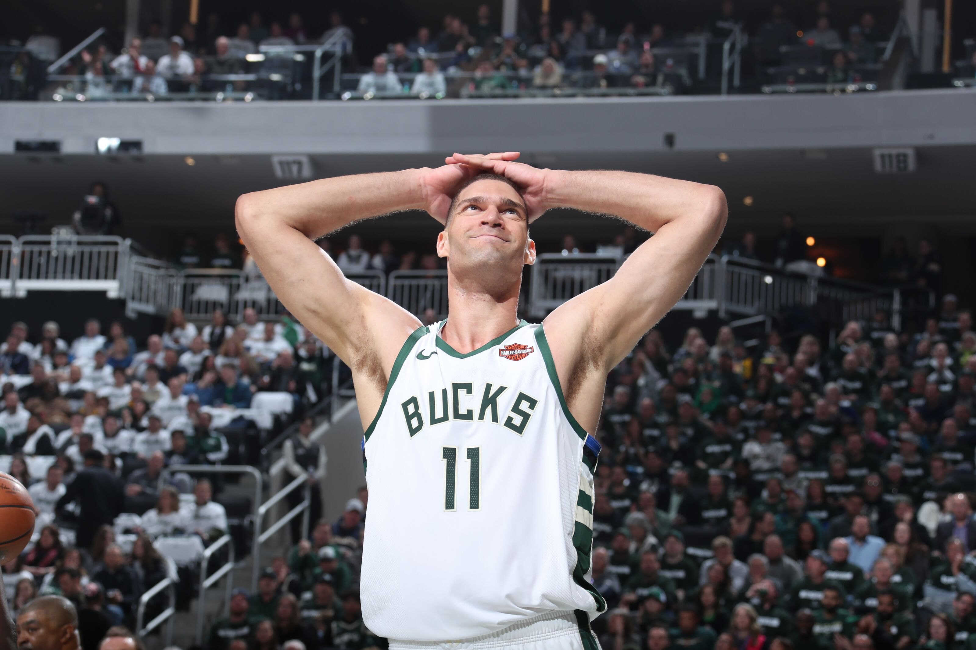 MILWAUKEE, WI - APRIL 14: Brook Lopez #11 of the Milwaukee Bucks smiles against the Detroit Pistons during Game One of Round One of the 2019 NBA Playoffs on April 14, 2019 at Fiserv Forum in Milwaukee, Wisconsin. NOTE TO USER: User expressly acknowledges and agrees that, by downloading and or using this photograph, User is consenting to the terms and conditions of the Getty Images License Agreement. Mandatory Copyright Notice: Copyright 2019 NBAE (Photo by Nathaniel S. Butler/NBAE via Getty Images)