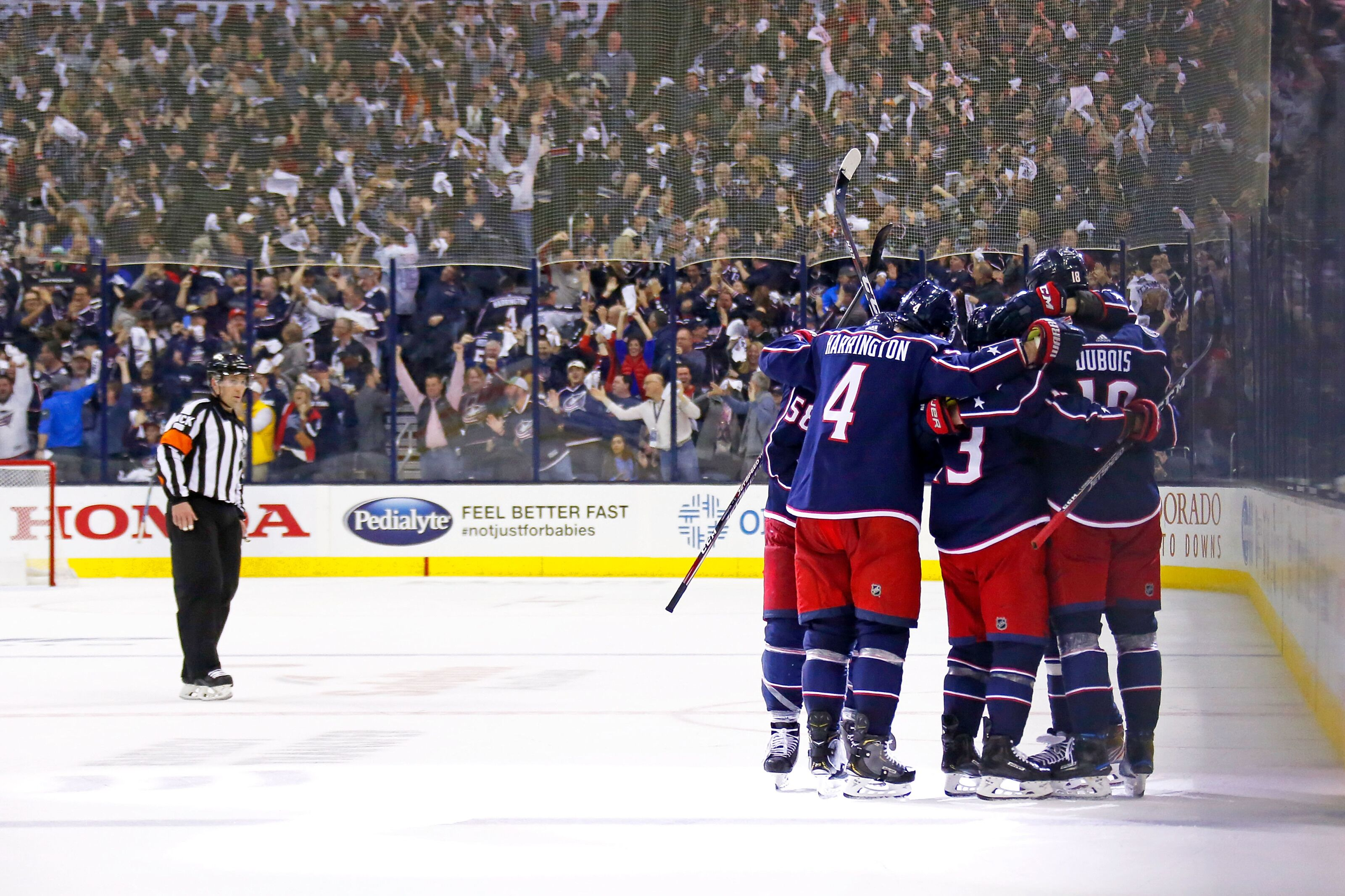 COLUMBUS, OH - APRIL 14: Cam Atkinson #13 of the Columbus Blue Jackets is congratulated by his teammates after scoring an empty net goal during the third period of Game Three of the Eastern Conference First Round against the Tampa Bay Lightning during the 2019 NHL Stanley Cup Playoffs on April 14, 2019 at Nationwide Arena in Columbus, Ohio. Columbus defeated Tampa Bay 3-1 to take a 3-0 series lead. (Photo by Kirk Irwin/Getty Images)