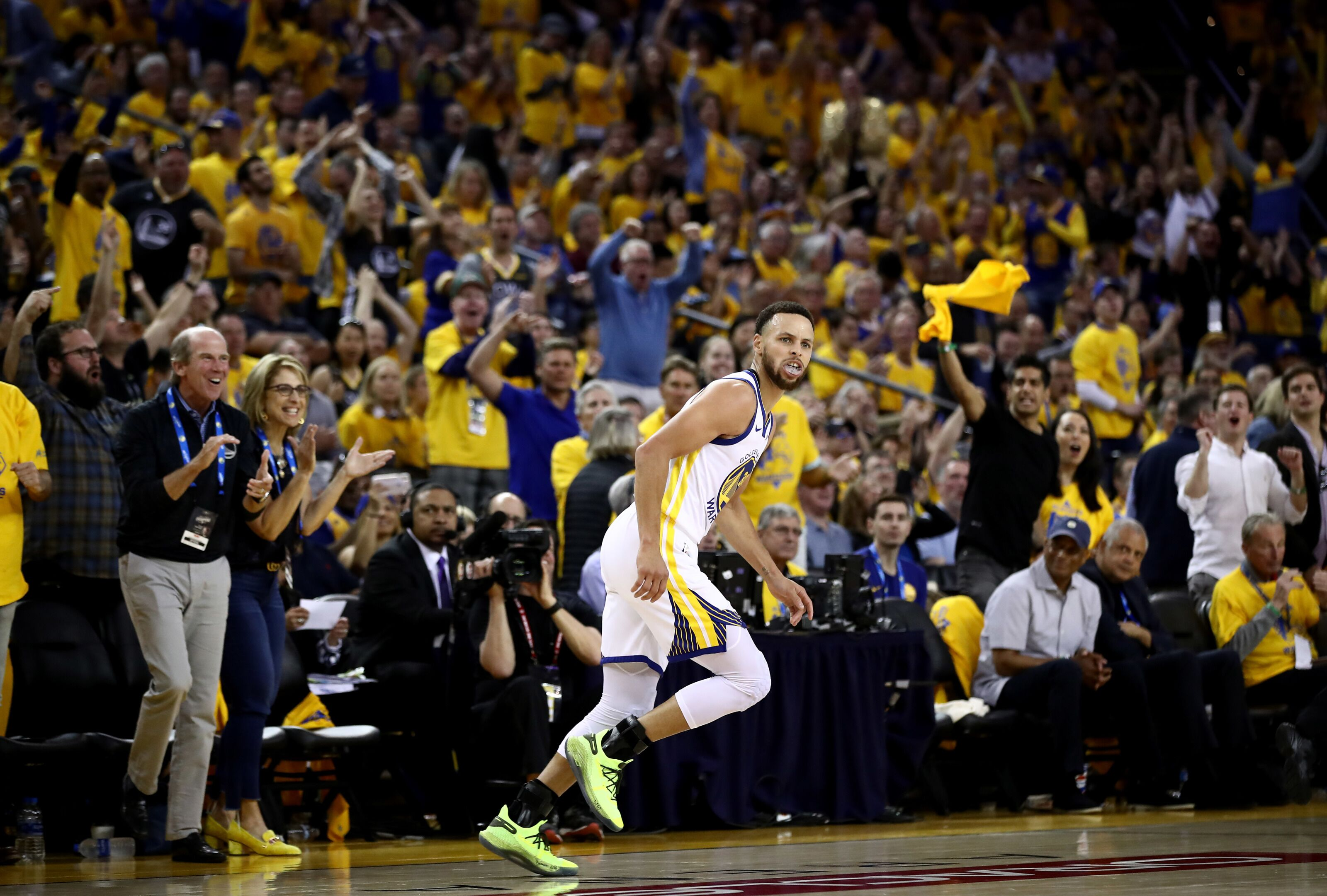 OAKLAND, CALIFORNIA - APRIL 13: Stephen Curry #30 of the Golden State Warriors runs back down court after making a basket against the LA Clippers during Game One of the first round of the 2019 NBA Western Conference Playoffs at ORACLE Arena on April 13, 2019 in Oakland, California. NOTE TO USER: User expressly acknowledges and agrees that, by downloading and or using this photograph, User is consenting to the terms and conditions of the Getty Images License Agreement. (Photo by Ezra Shaw/Getty Images)