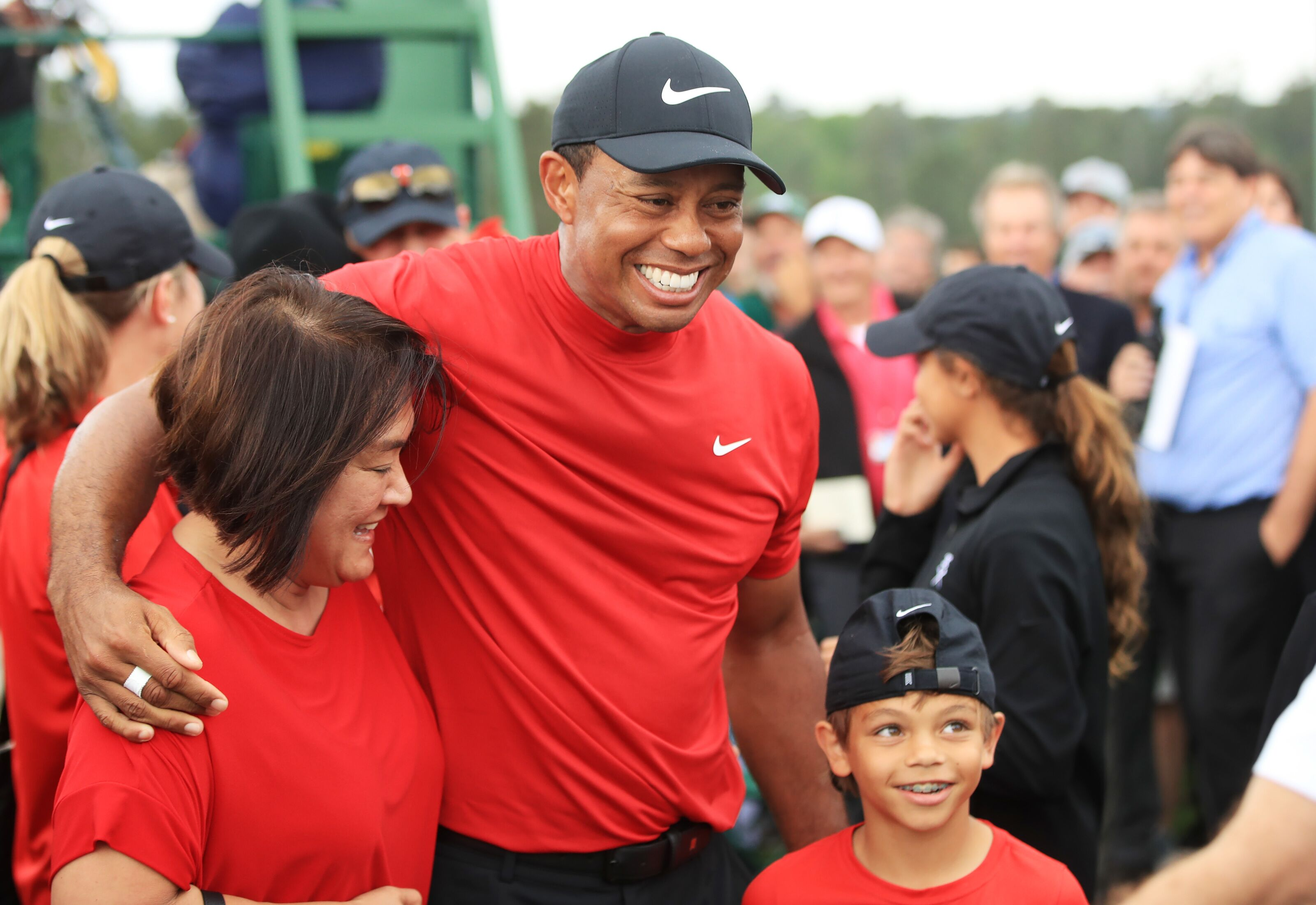 AUGUSTA, GEORGIA - APRIL 14: Tiger Woods of the United States celebrates with his son Charlie Axel as he comes off the 18th hole in honor of his win during the final round of the Masters at Augusta National Golf Club on April 14, 2019 in Augusta, Georgia. (Photo by Andrew Redington/Getty Images)