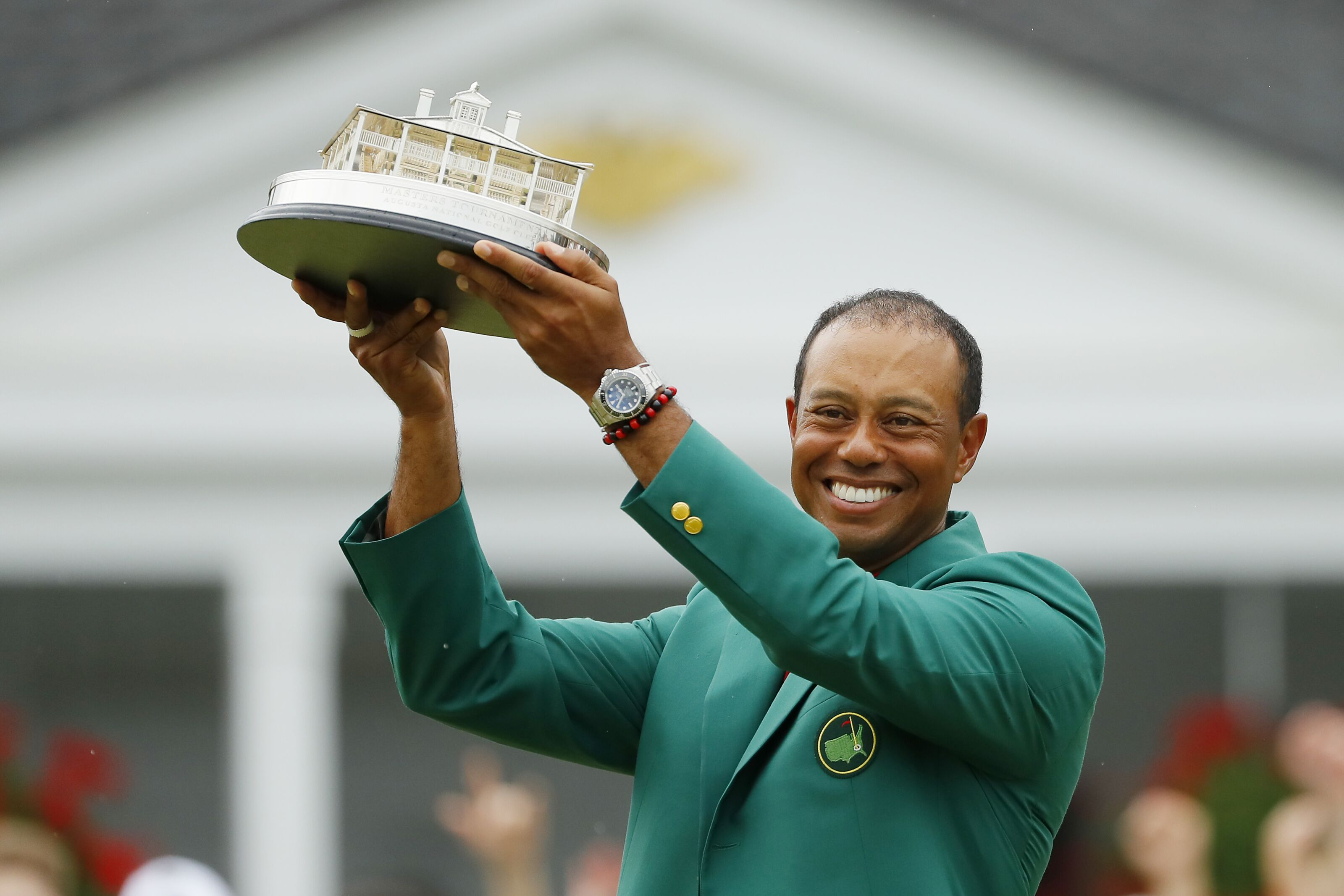 AUGUSTA, GEORGIA - APRIL 14: Tiger Woods of the United States celebrates with the Masters Trophy during the Green Jacket Ceremony after winning the Masters at Augusta National Golf Club on April 14, 2019 in Augusta, Georgia. (Photo by Kevin C. Cox/Getty Images)