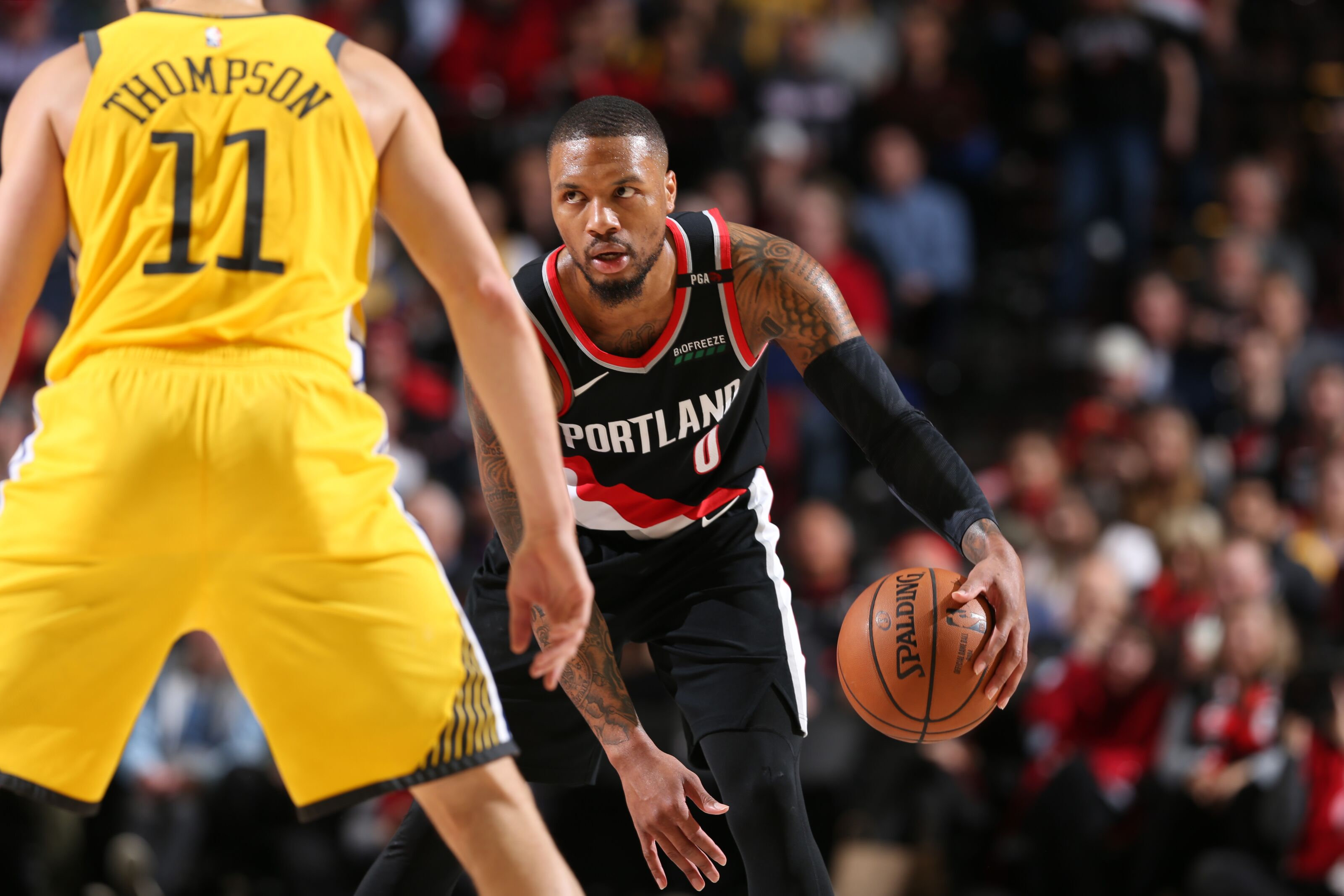 PORTLAND, OR - FEBRUARY 13: Damian Lillard #0 of the Portland Trail Blazers handles the ball against the Golden State Warriors on February 13, 2019 at the Moda Center in Portland, Oregon. NOTE TO USER: User expressly acknowledges and agrees that, by downloading and/or using this photograph, user is consenting to the terms and conditions of the Getty Images License Agreement. Mandatory Copyright Notice: Copyright 2019 NBAE (Photo by Sam Forencich/NBAE via Getty Images)